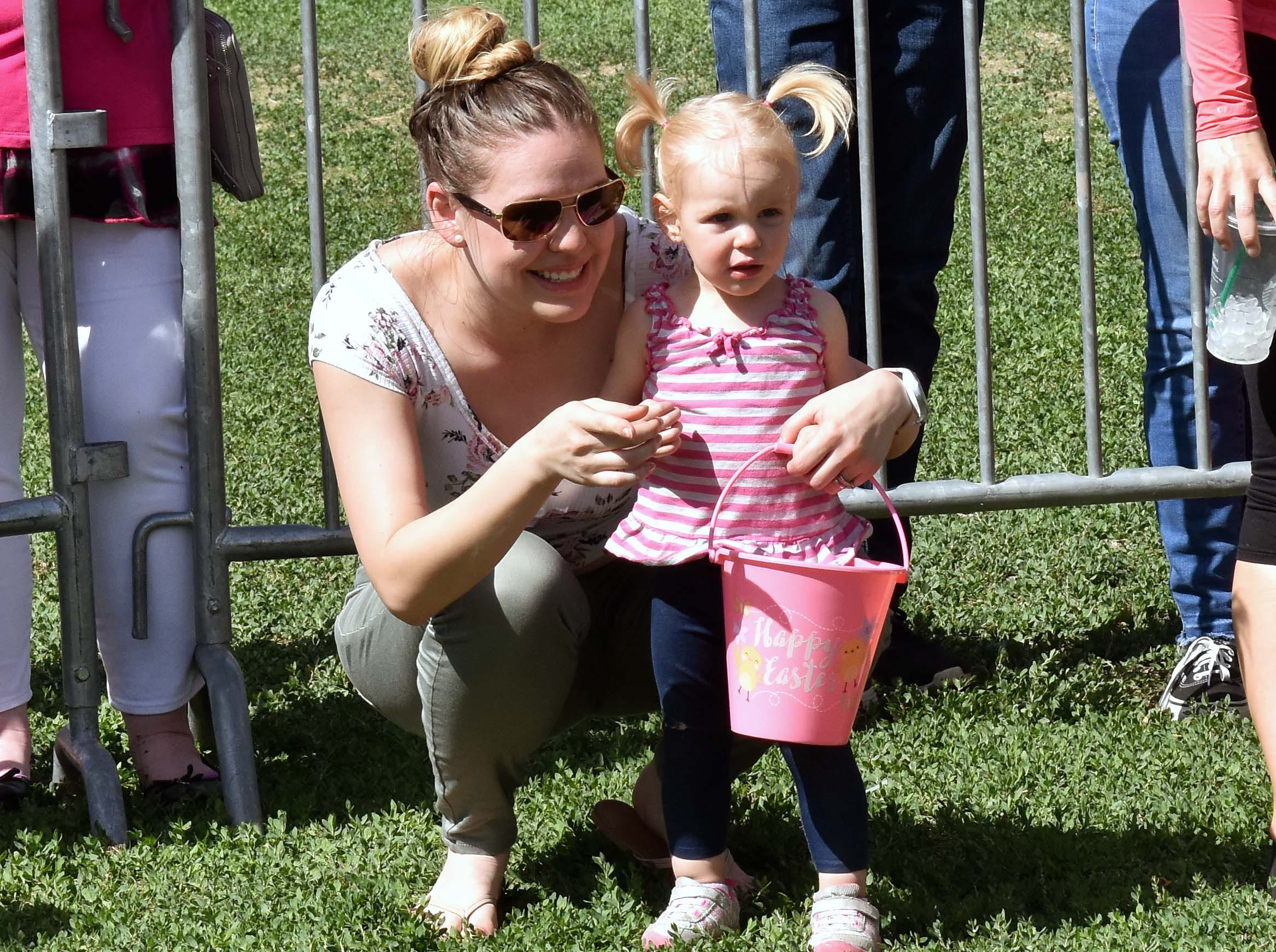 Zoe Hall, 2, gets directions from her mother Diana Hall during this year's SpringFest at Young Park on Saturday, April 20, 2019.