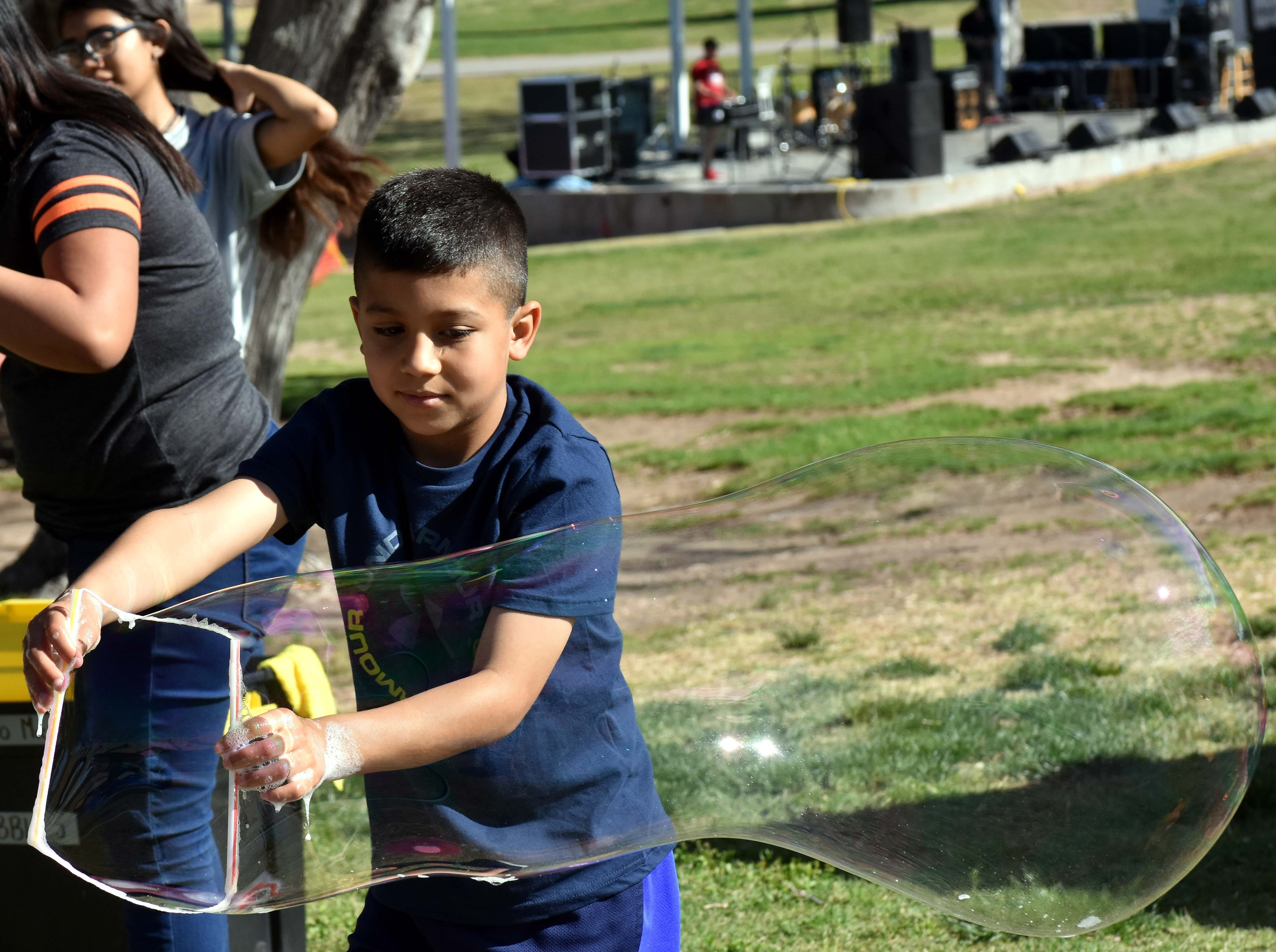 Noah Benavidez shows off his bubble-making skills during this year's SpringFest at Young Park on Saturday, April 20, 2019.