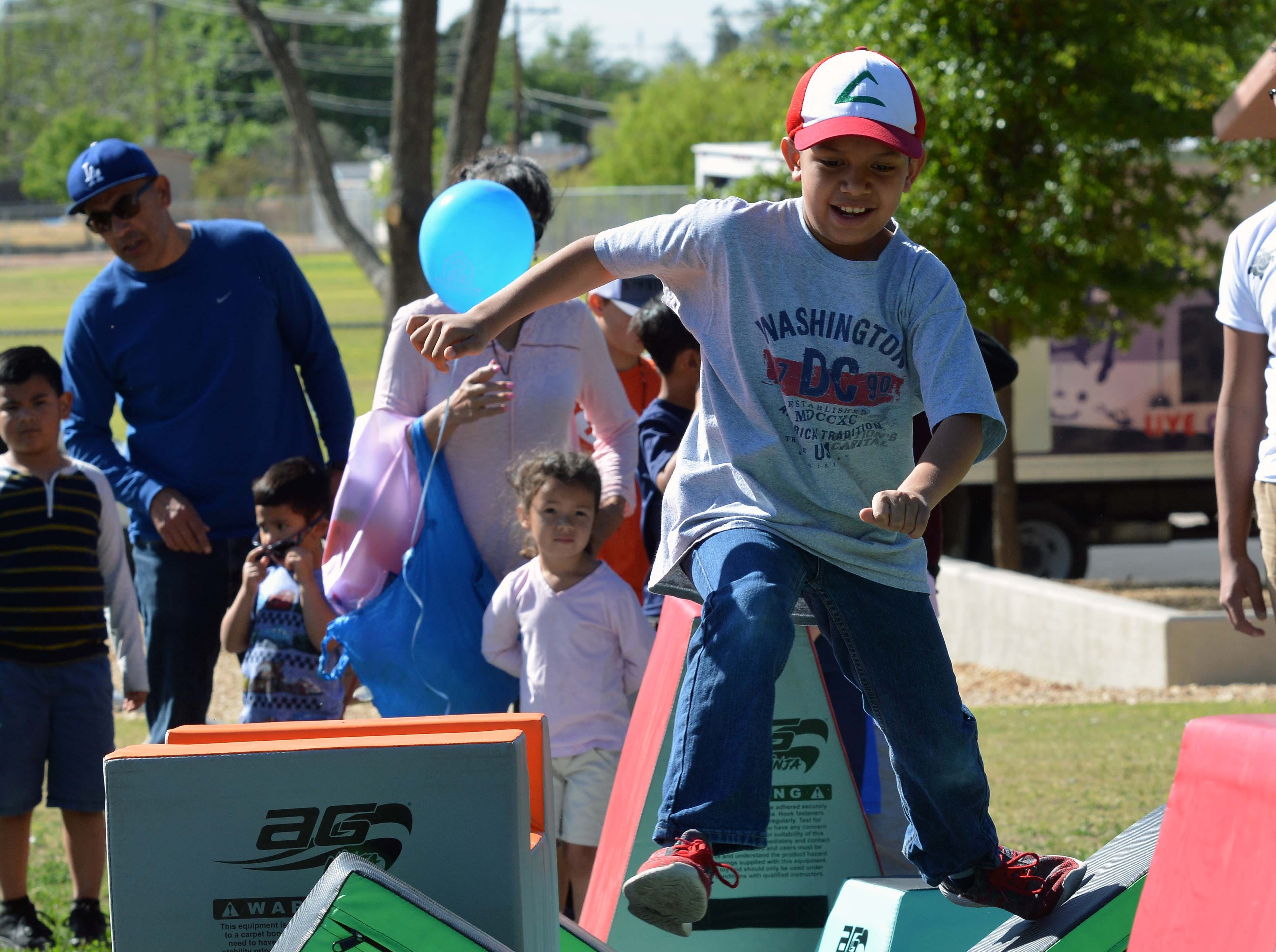 Nathaniel Benavidez runs the obstacle course that was set up as one of the many activities for the children to enjoy during this year's SpringFest at Young Park on Saturday, April 20, 2019.