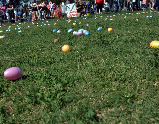 Easter Eggs litter the field as the kids get ready to go after them at this year's SpringFest at Young Park on Saturday, April 20, 2019.
