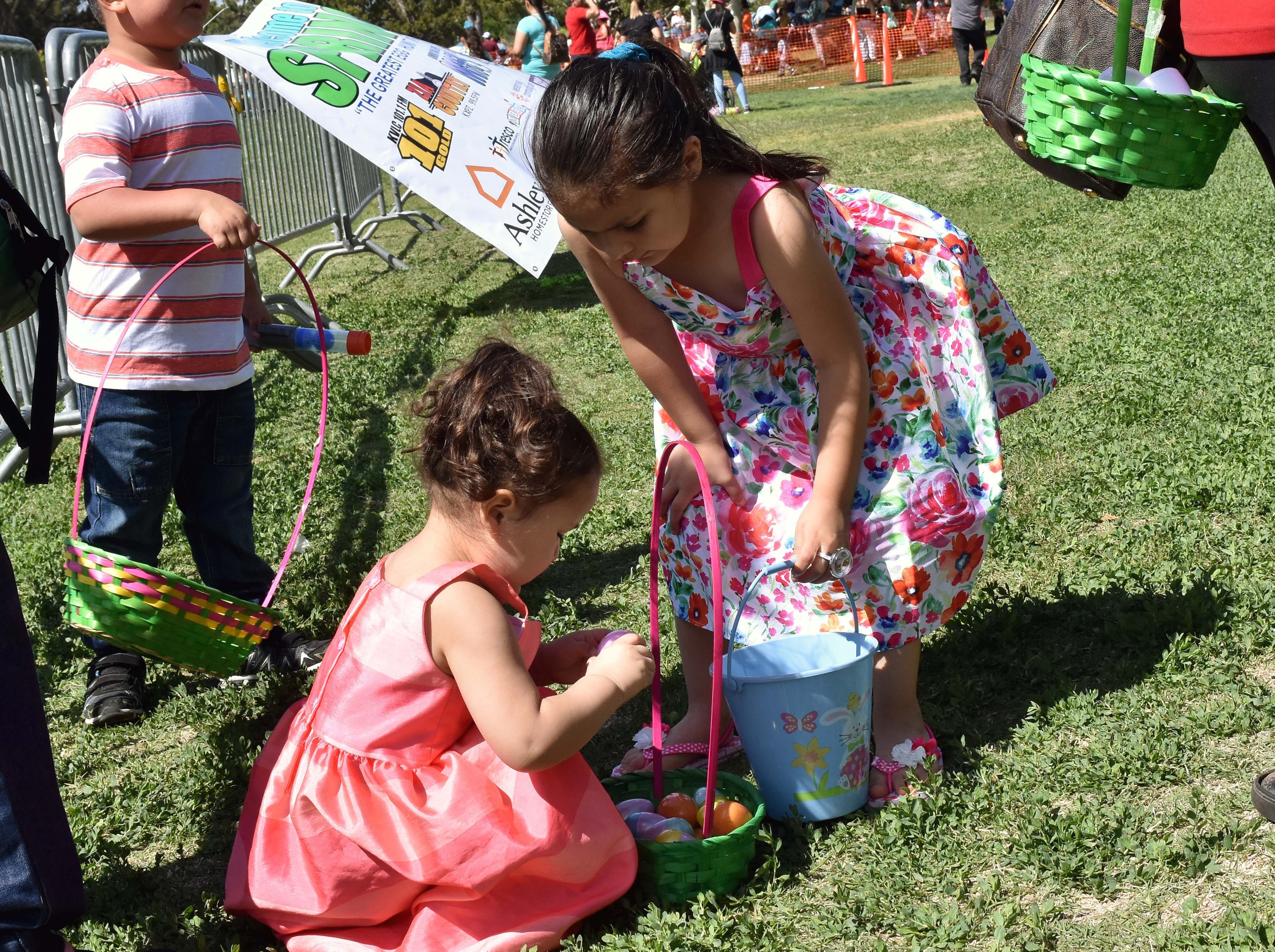 Amalia Gonzalez, left, and her sister Frankie Gonzalez check their baskets out after the SpringFest egg hunt at Young Park on Saturday, April 20, 2019.