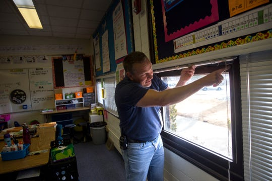 Country Club Elementary School Principal Shannon Waller points out the problems with one of the his classroom's windows on Friday, Jan. 12, 2018 at Country Club Elementary School in Farmington.