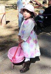 A picture-perfect Easter doll ready to collect eggs.