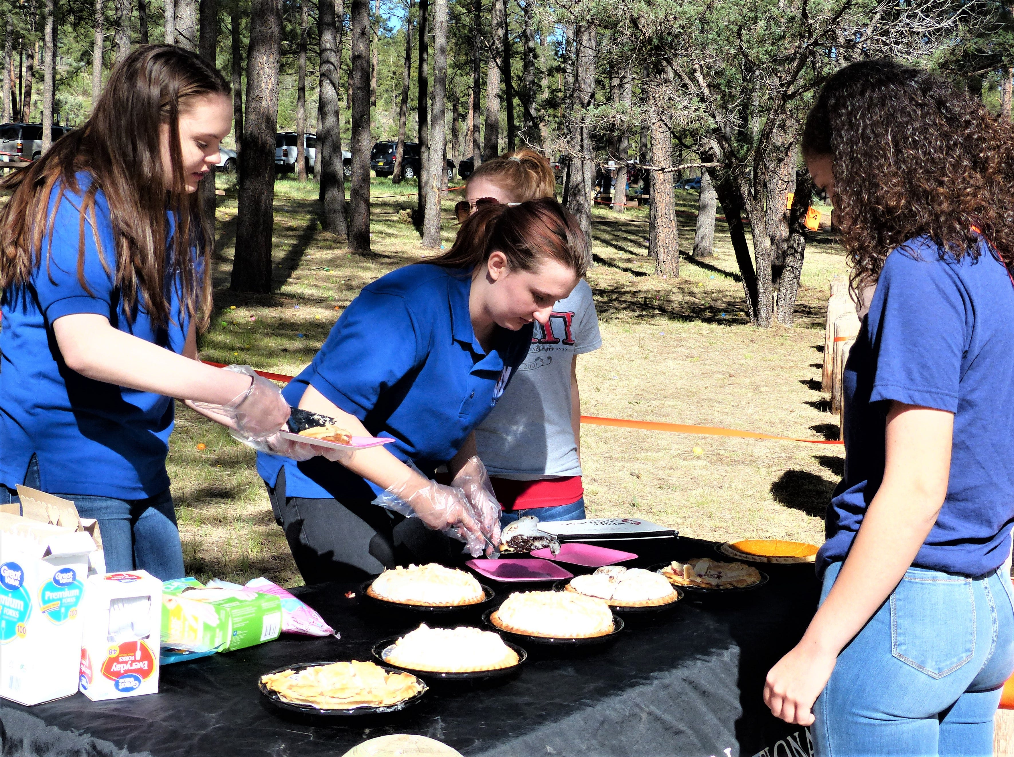 Members of the National Society of Leadership and Success cut big slices of pie and also raffled tickets to win a whole pie from Cornerstone Bakery to raise money for scholarships and other projects.