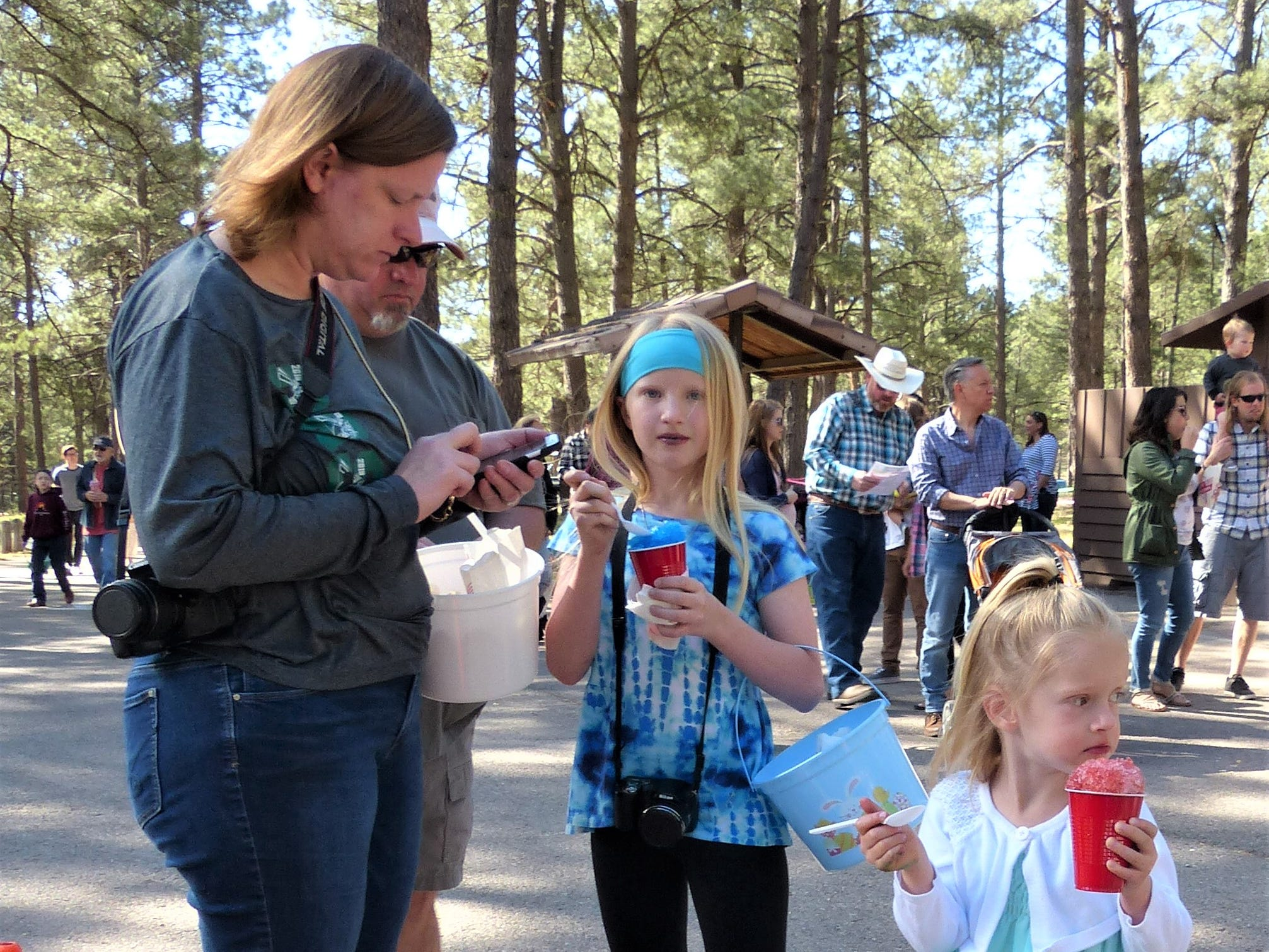 Sisters enjoy a snow cone before the egg hunt.