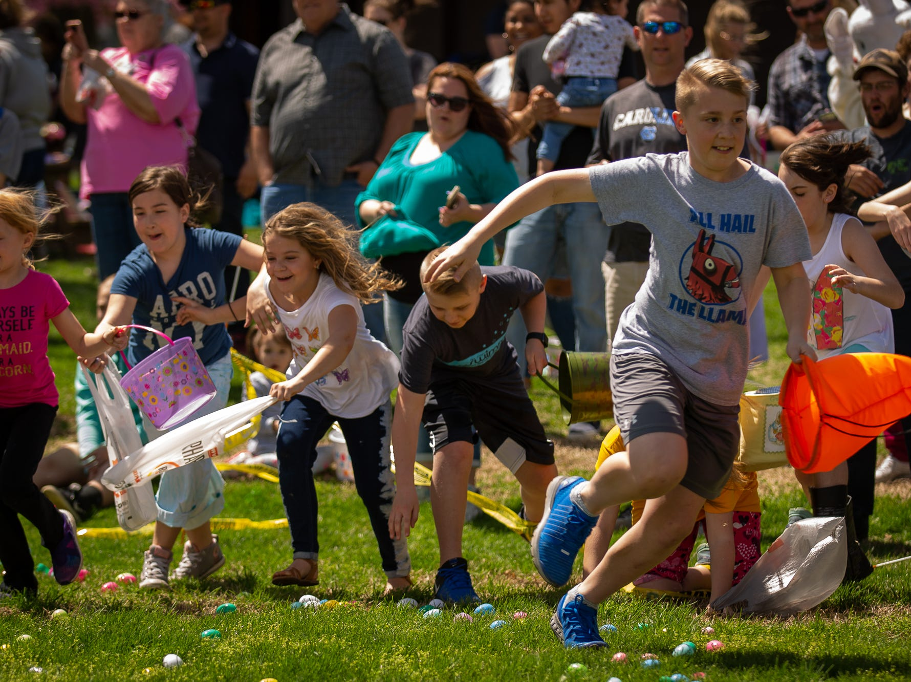 Kids collect Easter eggs during the 12th annual Hanover Community Easter Egg Hunt at Moul Field, Saturday, April 20, 2019, in Hanover.
