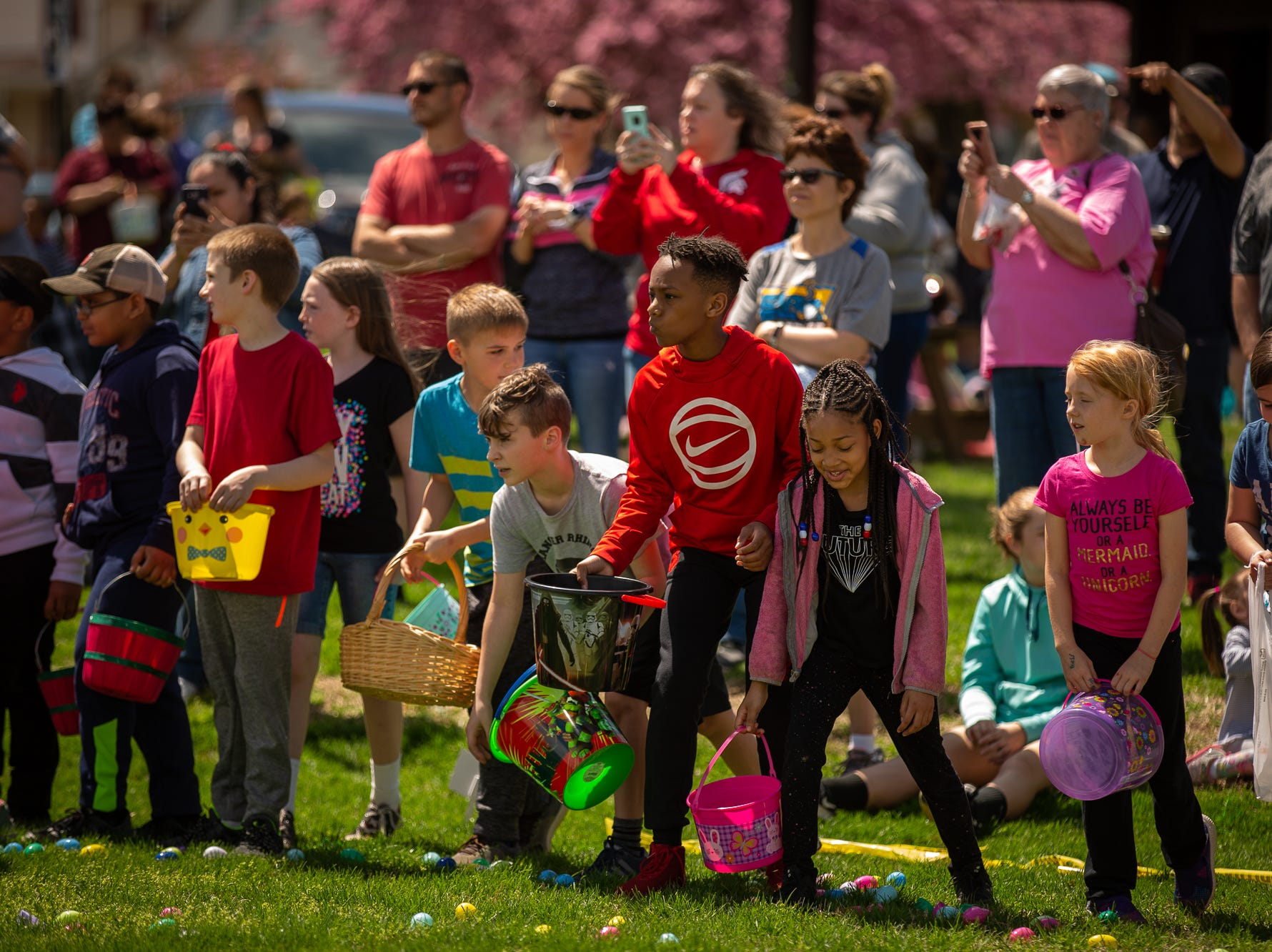 Kids wait to collect Easter eggs during the 12th annual Hanover Community Easter Egg Hunt at Moul Field, Saturday, April 20, 2019, in Hanover.