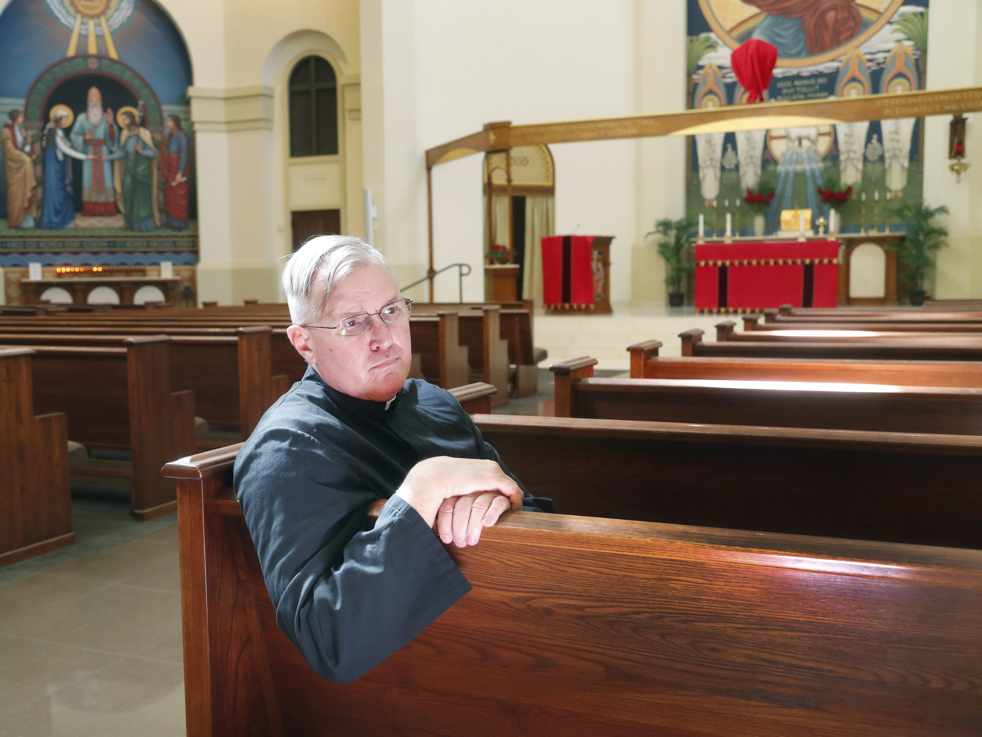 The Rev. Rob Clements sits inside the ASU Catholic Newman Center in Tempe, Ariz. April 14, 2019. In his congregation, he has not seen a trend of members leaving the church because of the sex scandal.