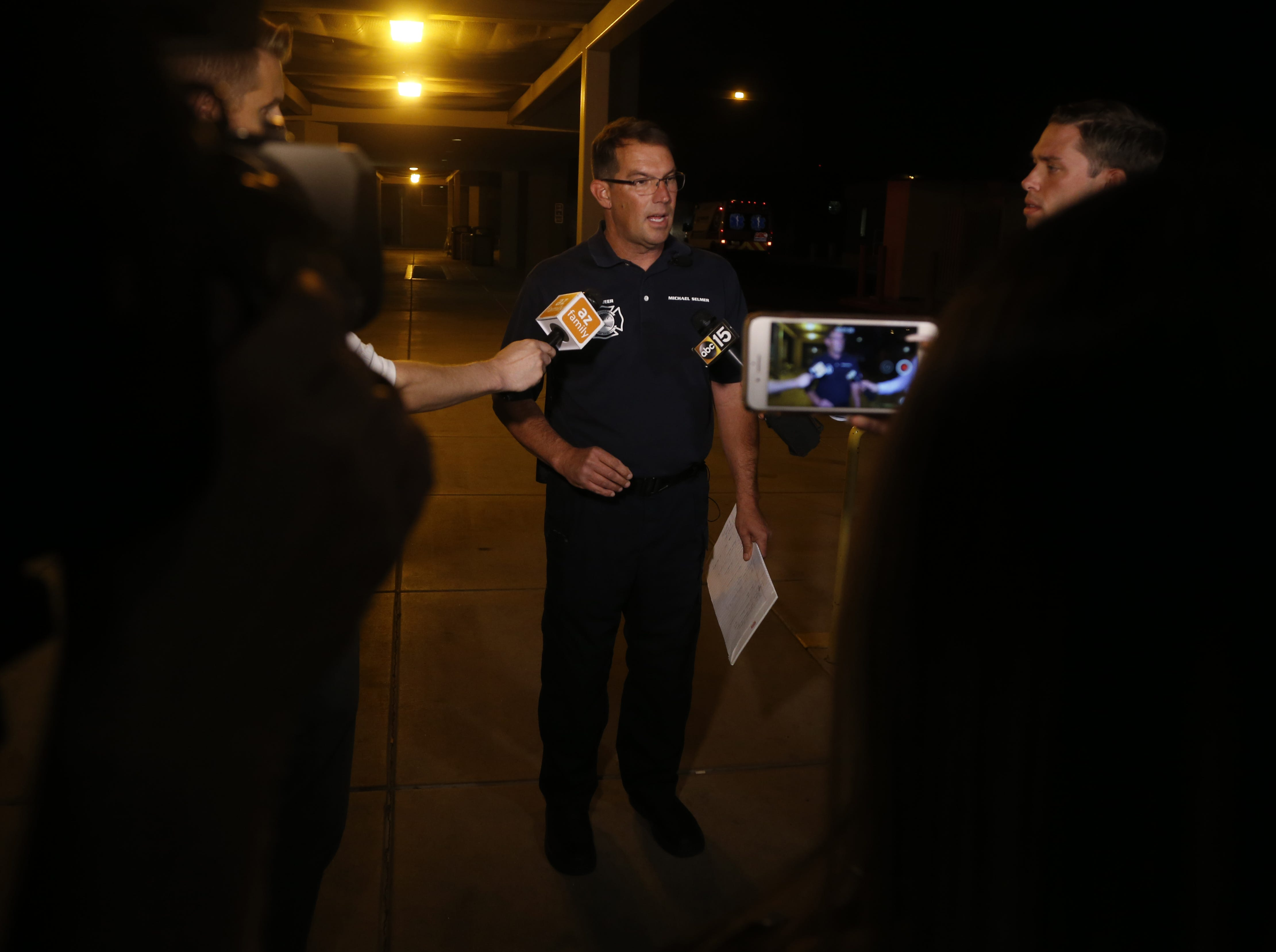 Peoria PIO Michael Selmer speaks to the press about injuries firefighters sustained responding to a call on Friday, April 19, 2019.