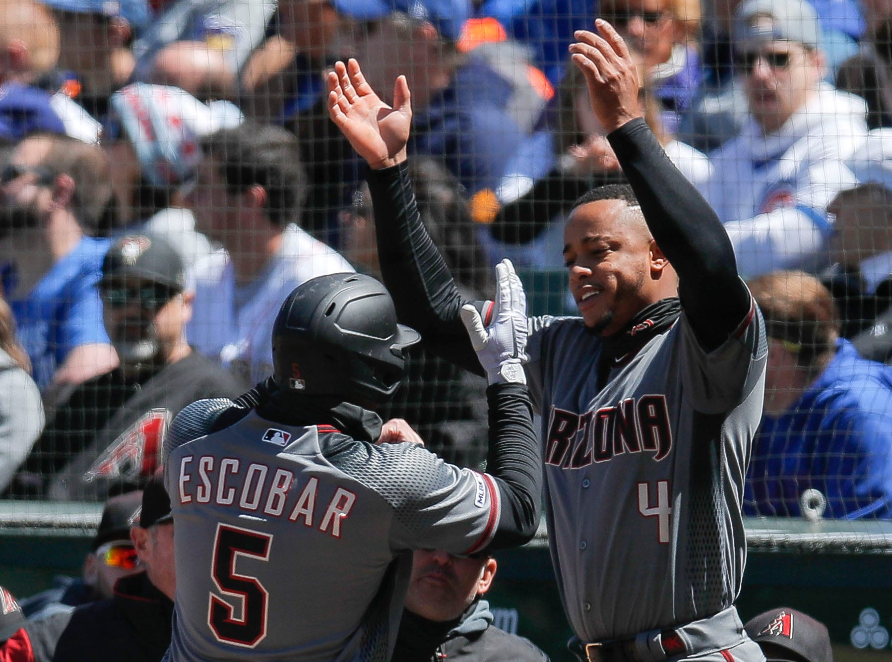 Eduardo Escobar celebrates a home run with Ketel Marte during the first inning of a game April 20 at Wrigley Field.