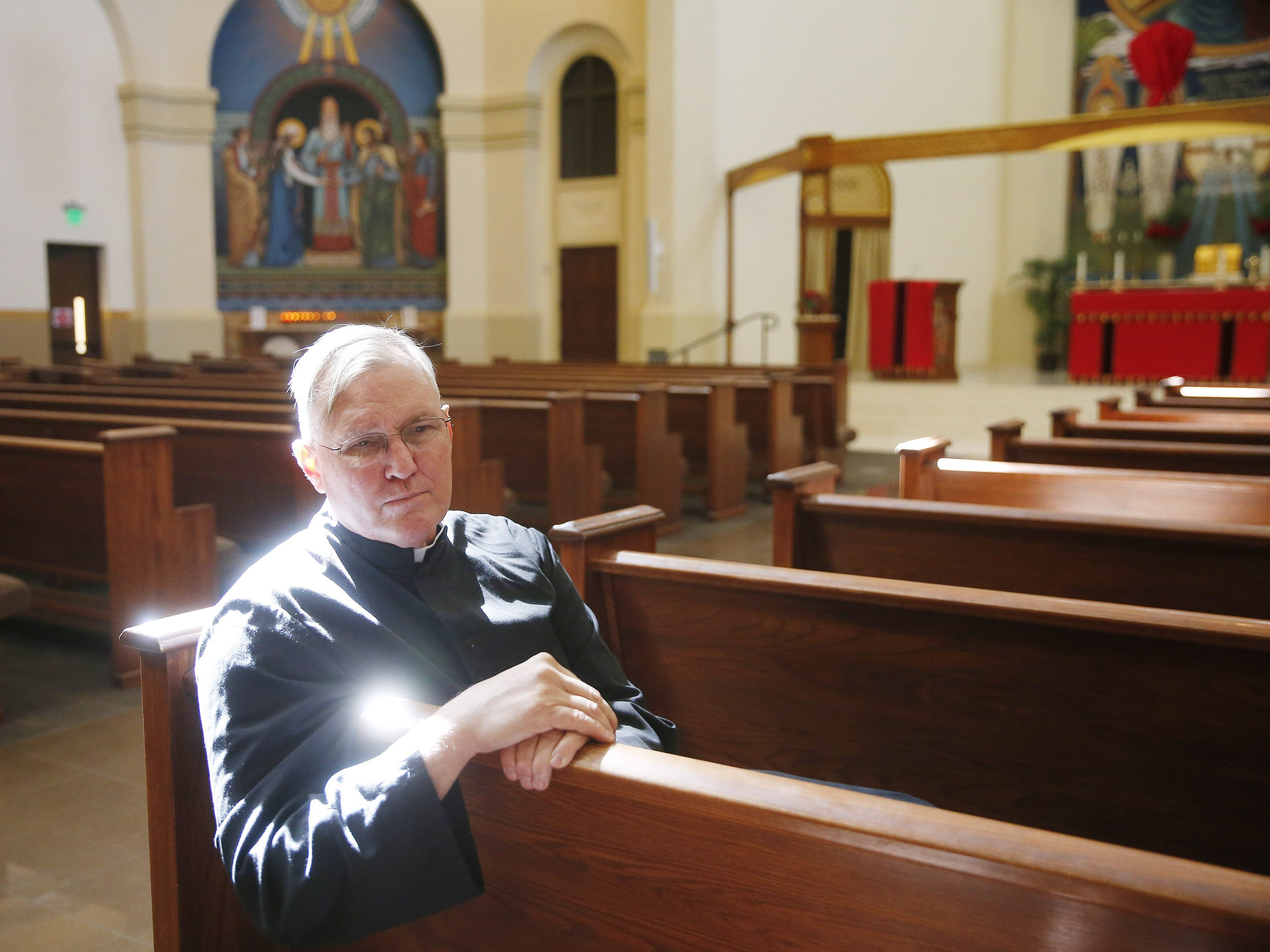 The Rev. Rob Clements sits inside the ASU Catholic Newman Center in Tempe, Ariz. April 14, 2019. He has not seen a trend in his congregation leaving the church because of the sex scandal.