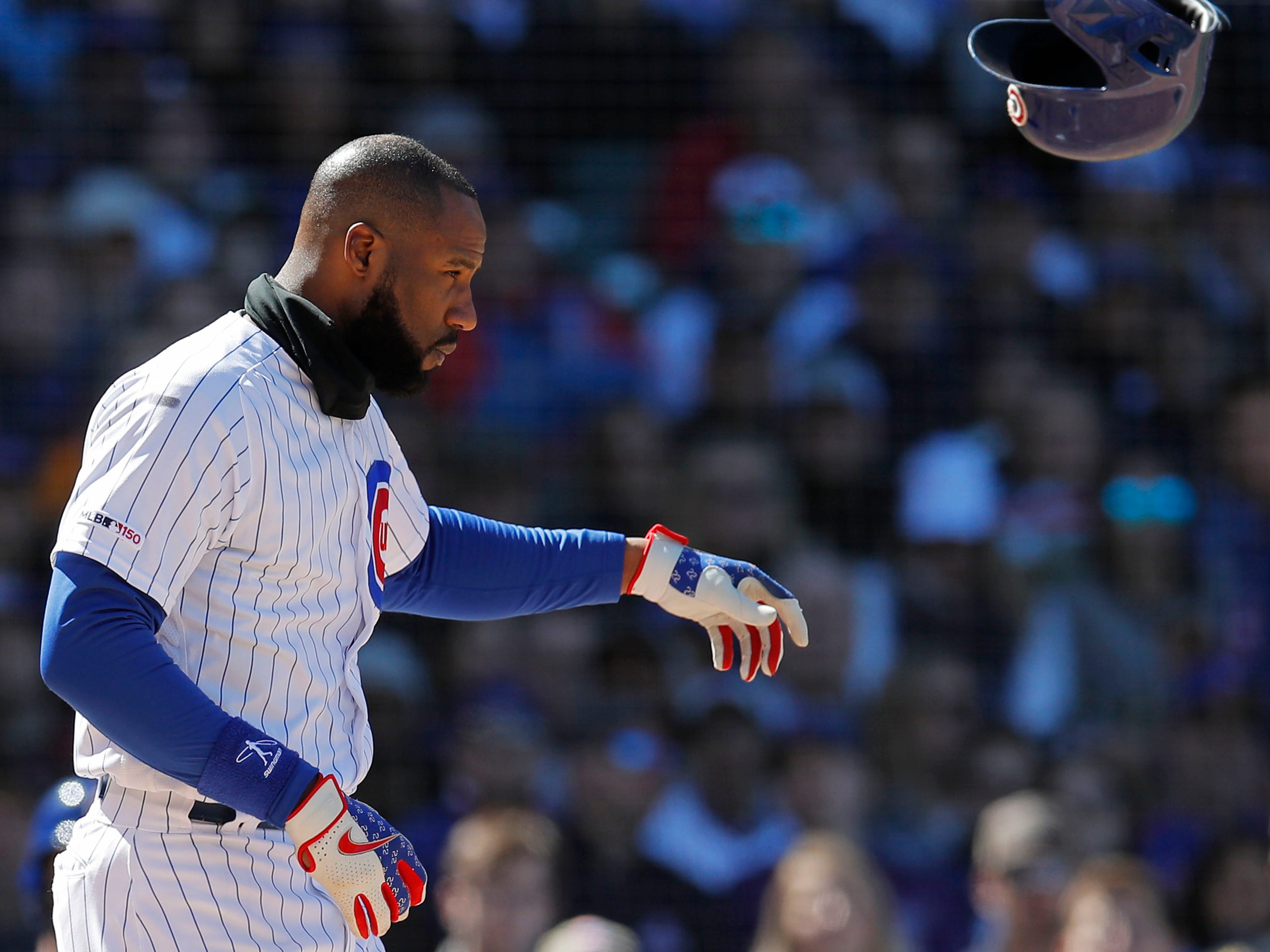 Cubs right fielder Jason Heyward tosses his helmet after striking out during the fourth inning of a game April 20 at Wrigley Field.