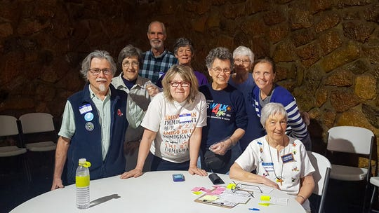 Michael and Ande McCarthy, front left and center, are pictured with other volunteers in El Paso, Texas.