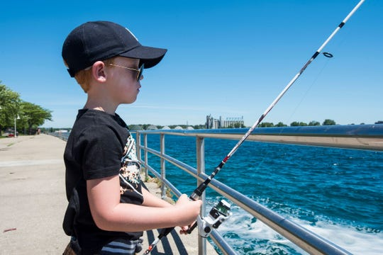 Julian Gladstone, 7, fishes Tuesday, July 3, 2018 along the St. Clair River in Port Huron.