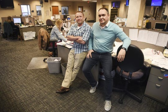 In this April 9, 2019, photo, Argus Leader investigative reporter Jonathan Ellis and news director Cory Myers in the newsroom in Sioux Falls, S.D. In 2010, reporters at South Dakota's Argus Leader newspaper came up with the idea of requesting data about the government's food assistance program. They thought the information about the $65-billion dollar-a year program, previously known as food stamps, could lead to a series of stories and help them identify possible fraud. But the government didn't provide everything the paper wanted. Trying to get the data has taken the paper more than eight years and landed the case at the Supreme Court.