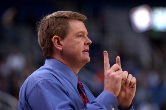 Reno coach Shane Foster signals his team during the game against Silverado at the state championship tournament on Feb. 21, 2008.