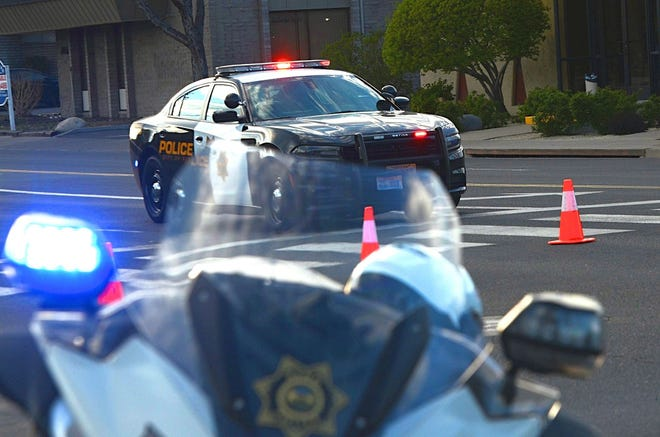 A photo showing a Reno police vehicle and motorcycle with flashing lights.