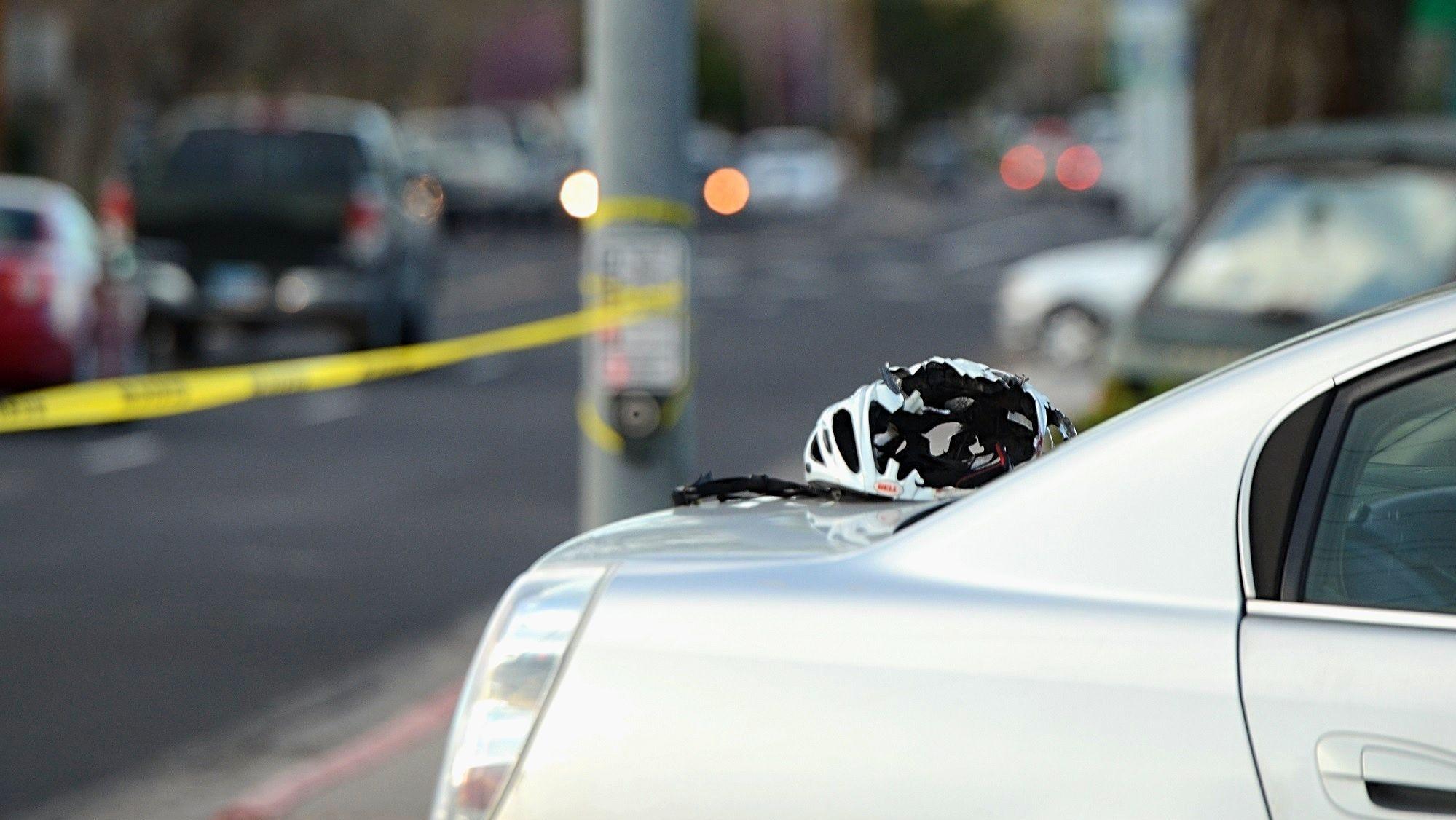 A broken helmet is seen atop of a car following a...