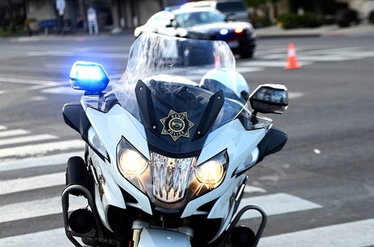 A photo showing a Reno police motorcycle with flashing lights.
