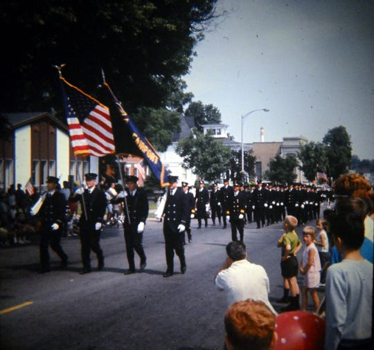 An image of the 1967 Fairport Centennial Parade on Main Street in the village.