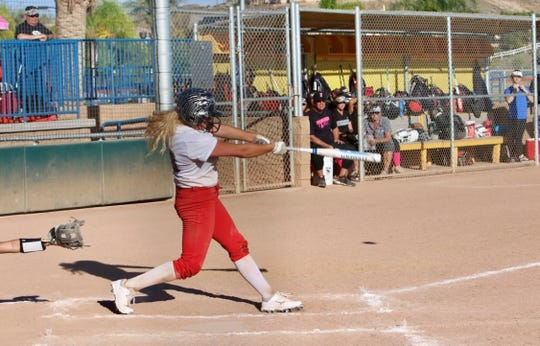Foothill senior Madison Helman swings at a pitch during a Huntington Beach tournament with her club team, the Firecrackers.