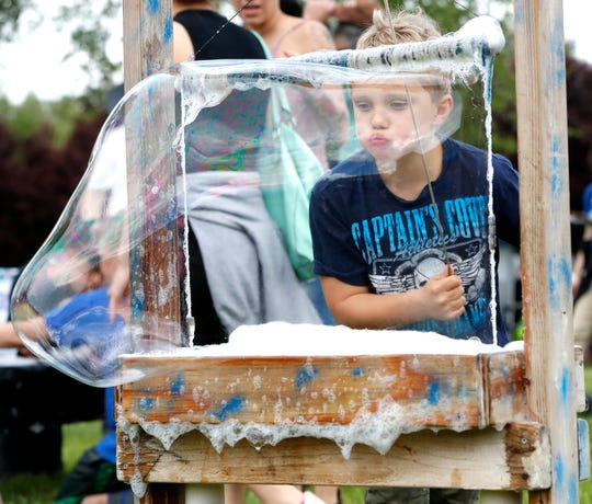 Devin Lavoie blows a giant bubble Saturday during the Whole Earth and Watershed Festival.
