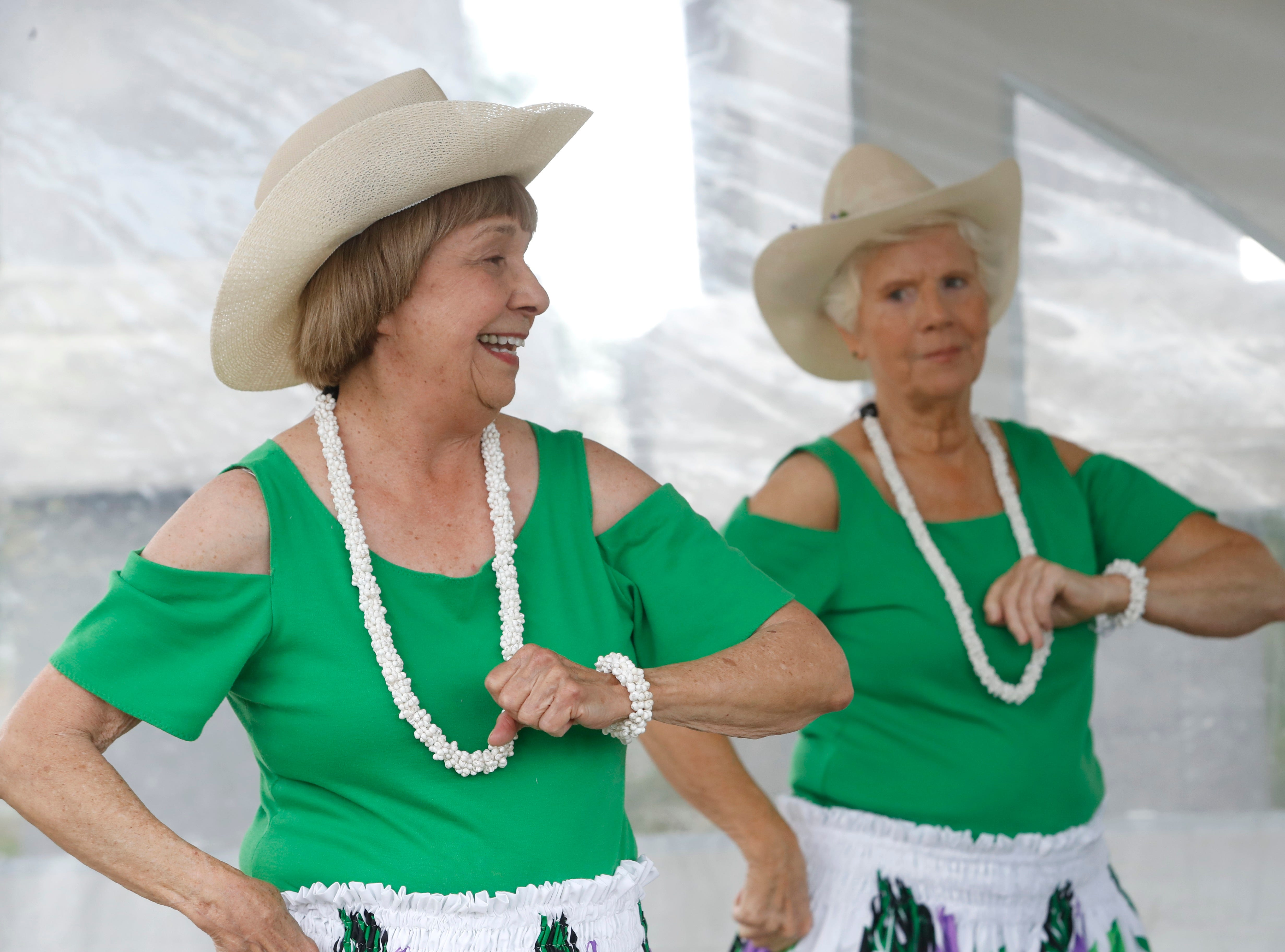 Sandy Jones, left, and Marsha Derby give a hula performance Saturday with their Nani Wale Na Kupuna group from the Redding Senior Center during the Whole Earth and Watershed Festival at Redding City Hall.