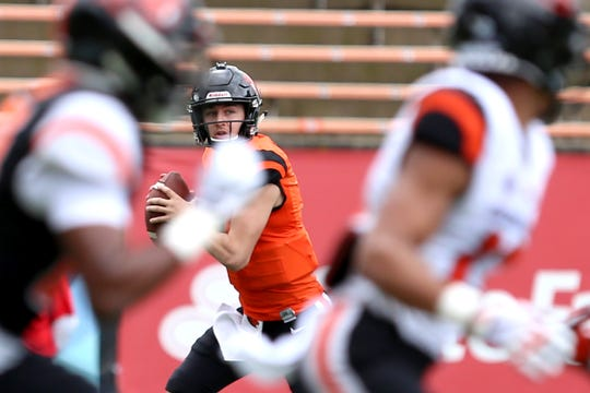 Quarterback Tristan Gebbia (3) looks for an opening during Oregon State University's spring football game at Reser Stadium in Corvallis on April 20, 2019.