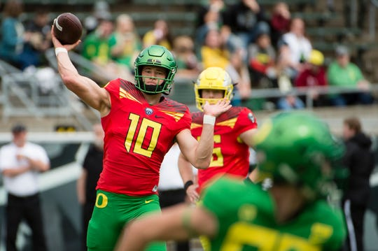 Oregon Ducks quarterback Justin Herbert (10) throws a pass before the start of the Oregon spring game at Autzen Stadium.