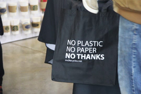 """A bag reads """"No Plastic, No Paper, No Thanks"""" at the 20th annual Earth Day event at The Oregon Garden on April 20, 2019."""