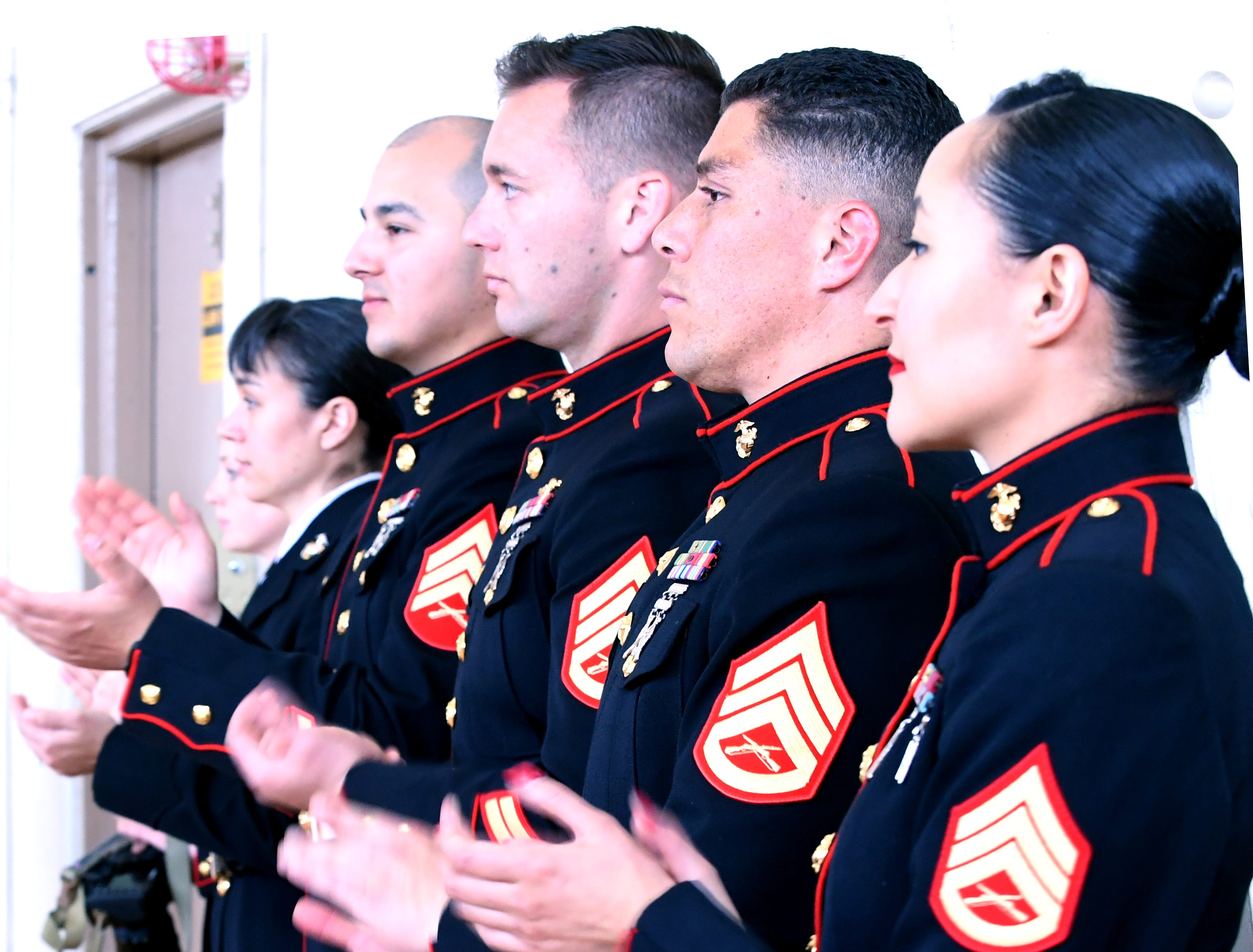 Marine Corps members clap for the newly-enlisted Saturday. April 20, 2019.
