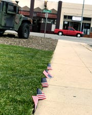 Small American flags lined the sidewalk outside the Police Activities League Building Saturday during the Heroes of Monterey County event. April 20, 2019.