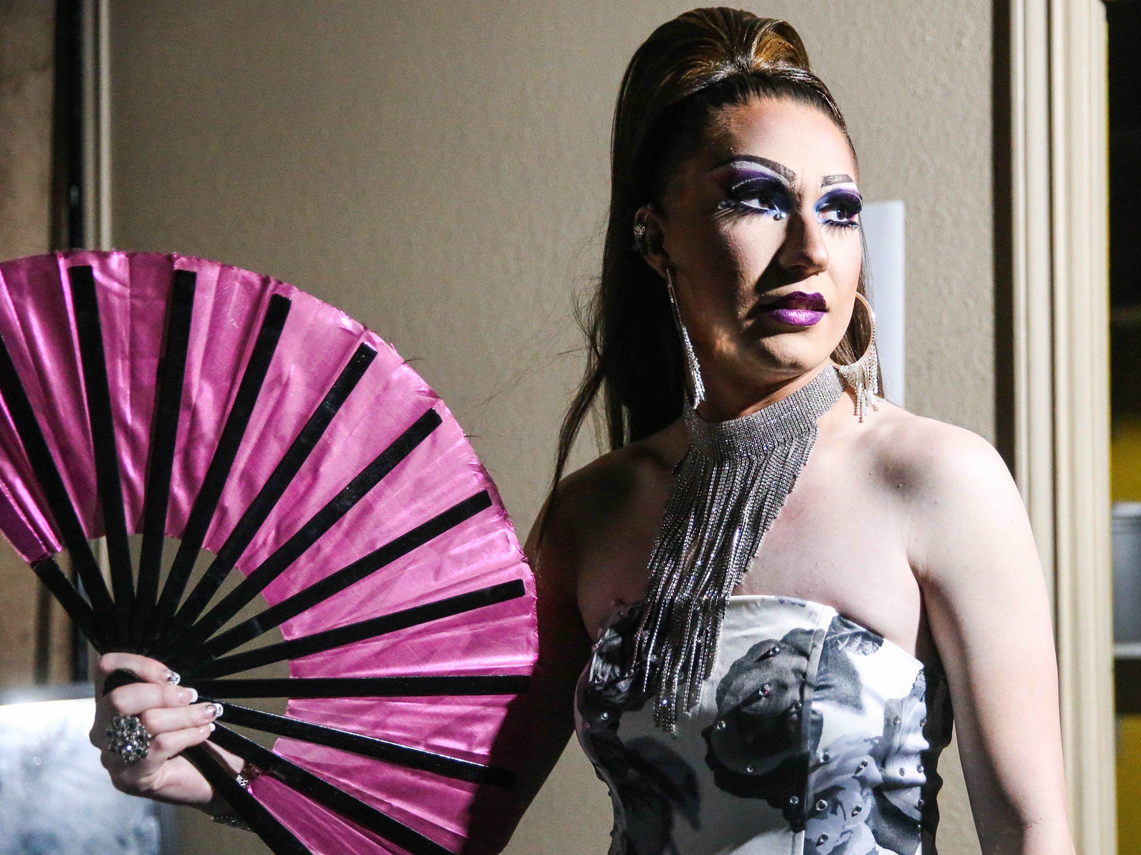 Zelieghia Reignz Paris tries out a fan before the drag show Friday, April 19, 2019, at the Beauregard.