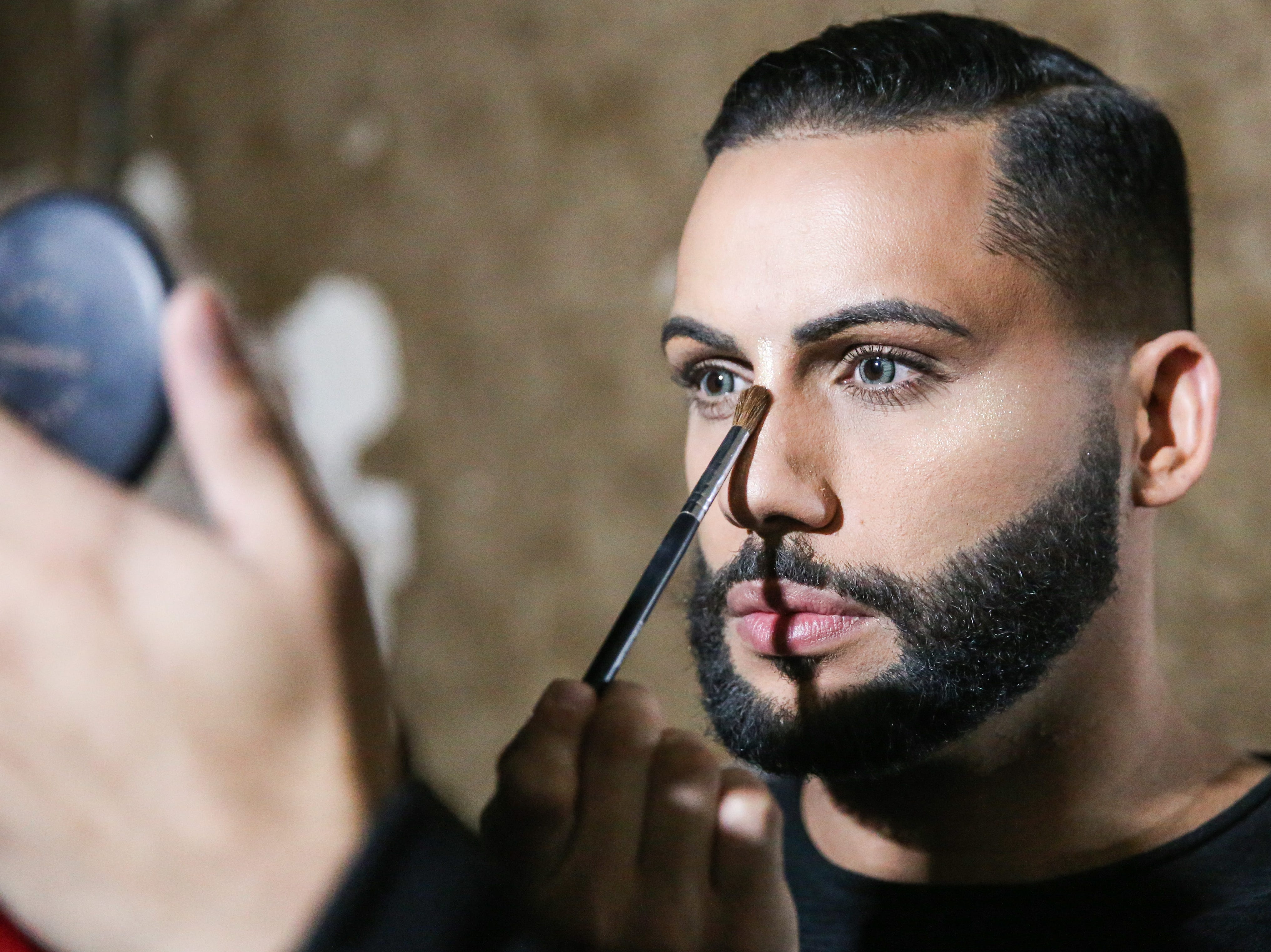 Aries Fatale applies makeup before the drag show Friday, April 19, 2019, at the Beauregard.