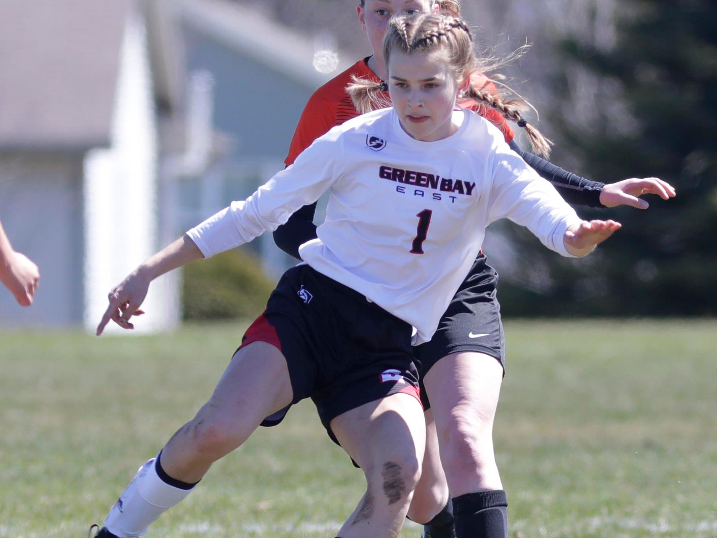 Green Bay East's Ellena Gallegas (1) moves the ball against Hartford at the Sheboygan South Soccer tournament, Saturday, April 20, 2019, in Sheboygan, Wis.