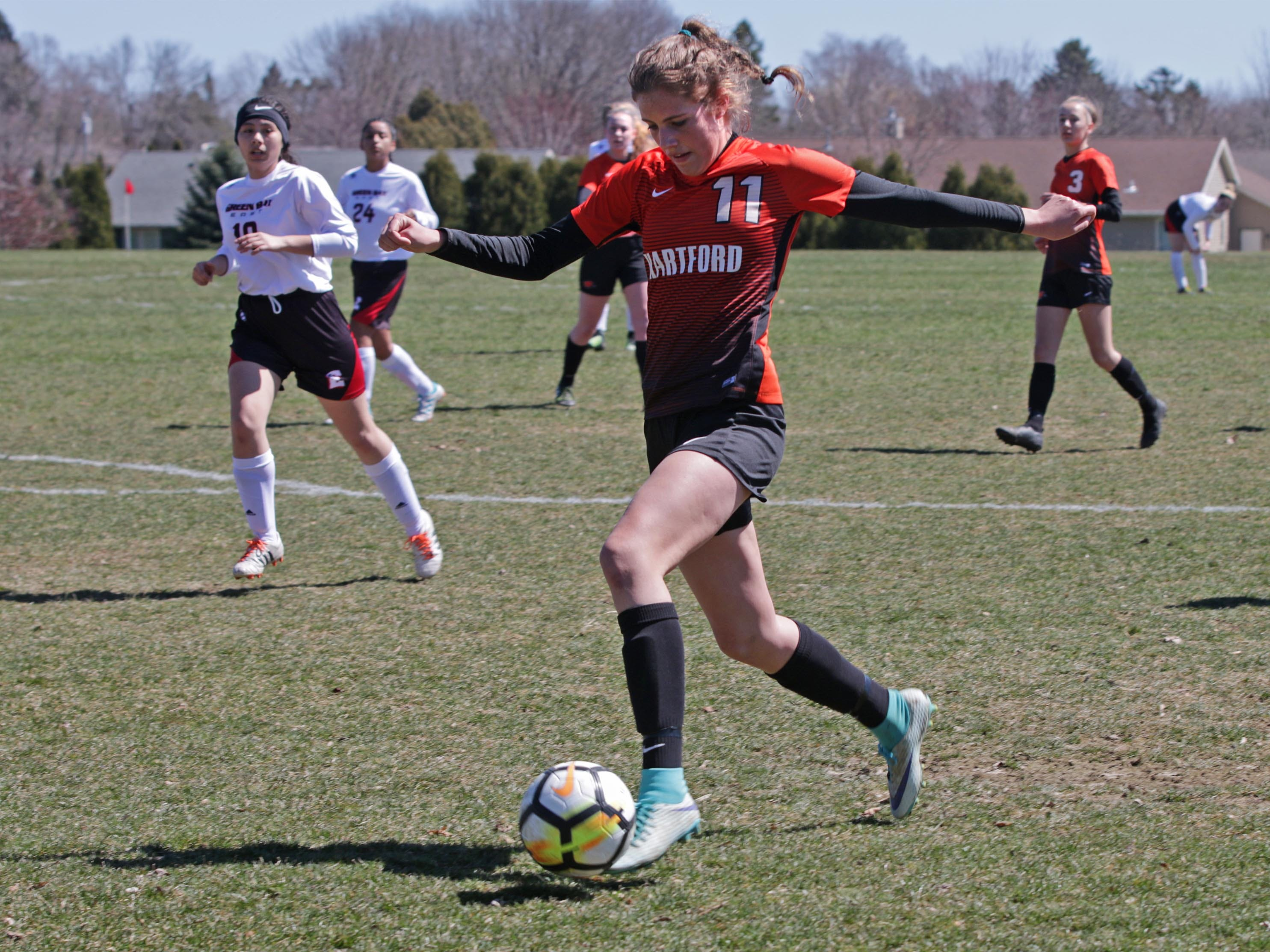 Hartford's Abby Hoffmann (11) moves the ball against Green Bay East at the Sheboygan South Soccer tournament, Saturday, April 20, 2019, in Sheboygan, Wis.
