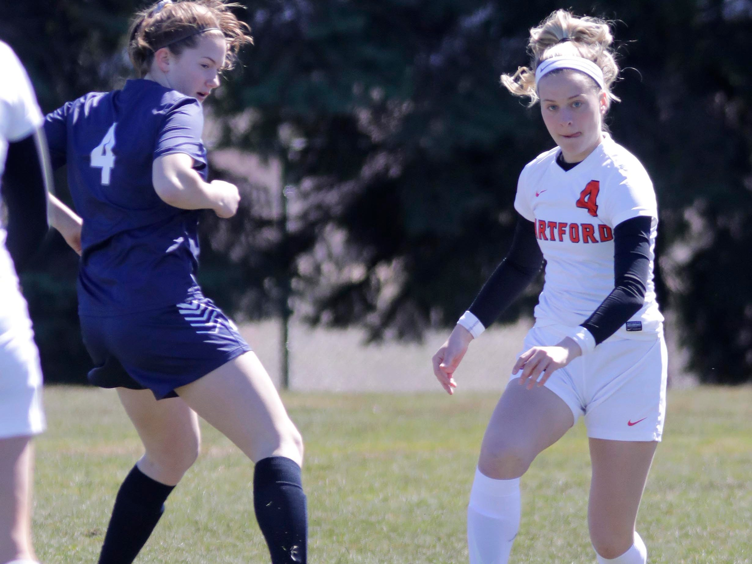 Sheboygan North's Maggie Mueller (4) looks at the ball as Hartford's Maddie Hoxworth (4) looks to pass the ball at the Sheboygan South Soccer tournament, Saturday, April 20, 2019, in Sheboygan, Wis.