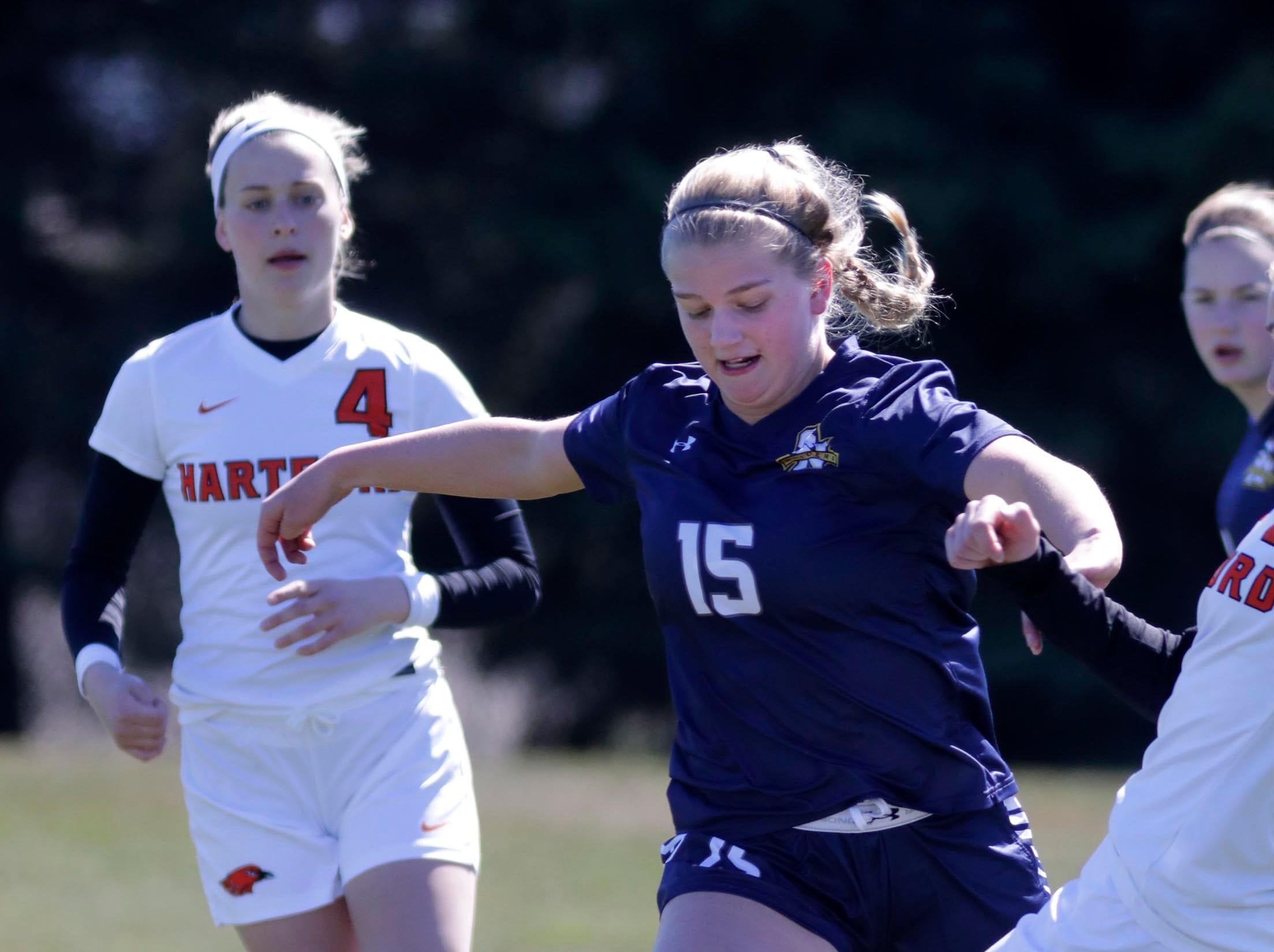Sheboygan North's Lizzie Revelis (15) moves the ball against Hartford, at the Sheboygan South Soccer tournament, Saturday, April 20, 2019, in Sheboygan, Wis.