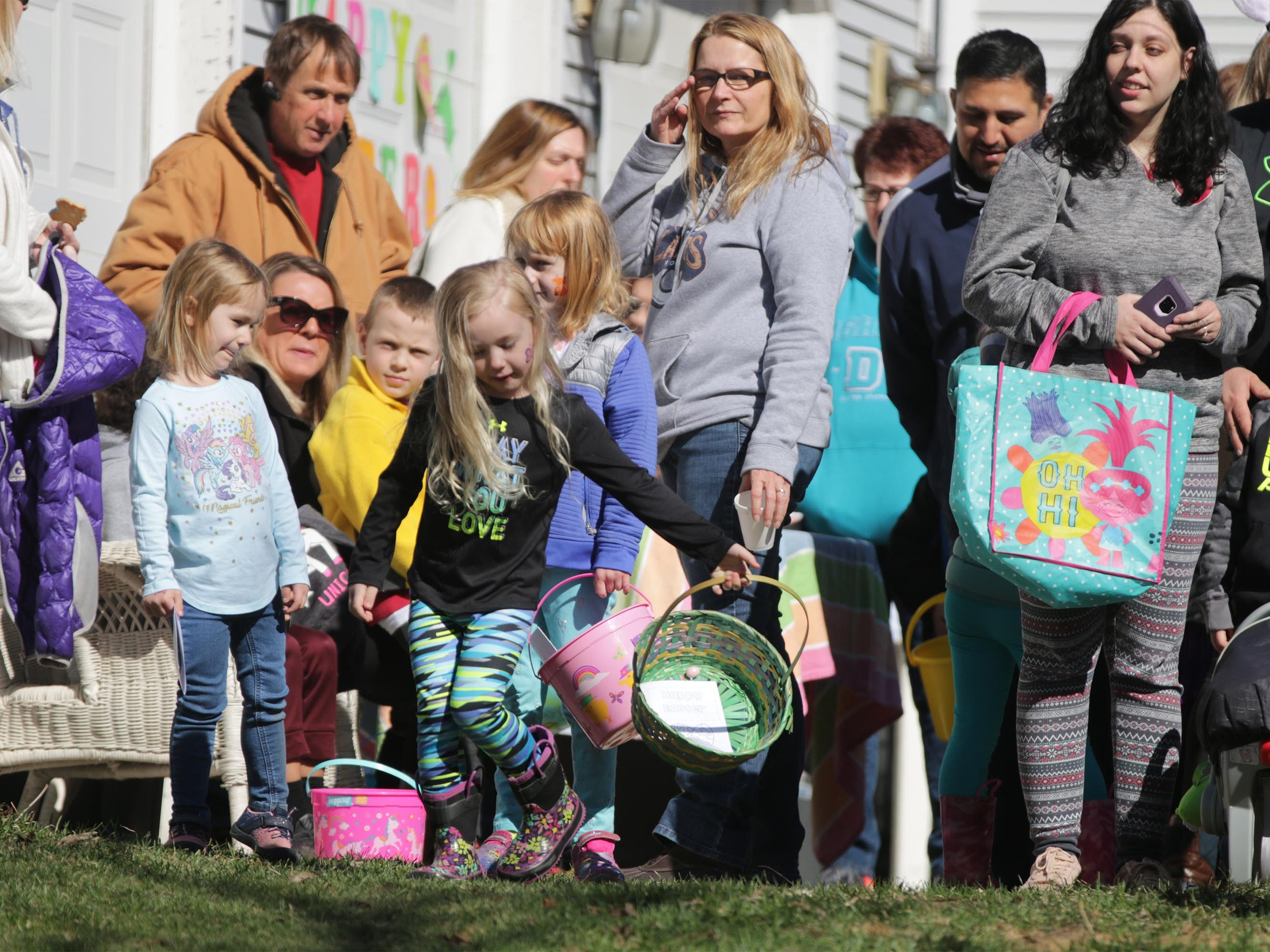 Children anxiously twirl around beore the start of the Hocevar Easter Egg Hunt, Saturday, April 20, 2019, in Sheboygan Falls, Wis.  This years marks 25 years for the Hocevar Family holding an Easter egg hunt at their home, according to Kathy Hocevar.
