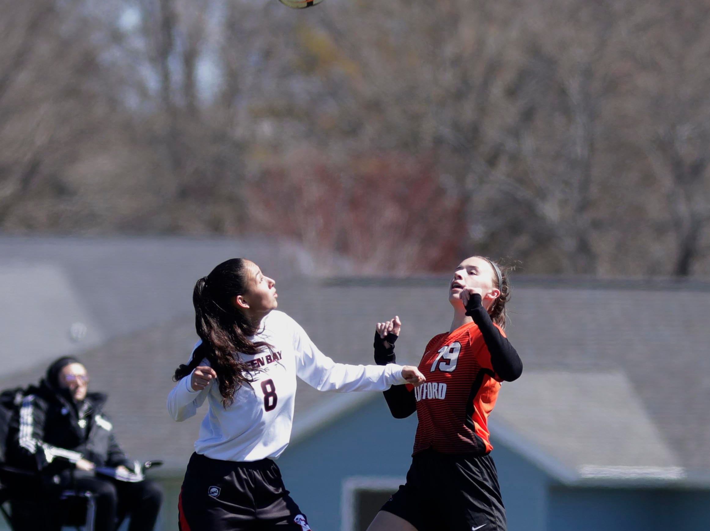 Green Bay East's Adriana Del Rio (8) and Hartford's Sydney Gifford (19) keep their eyes on the ball at the Sheboygan South Soccer tournament, Saturday, April 20, 2019, in Sheboygan, Wis.