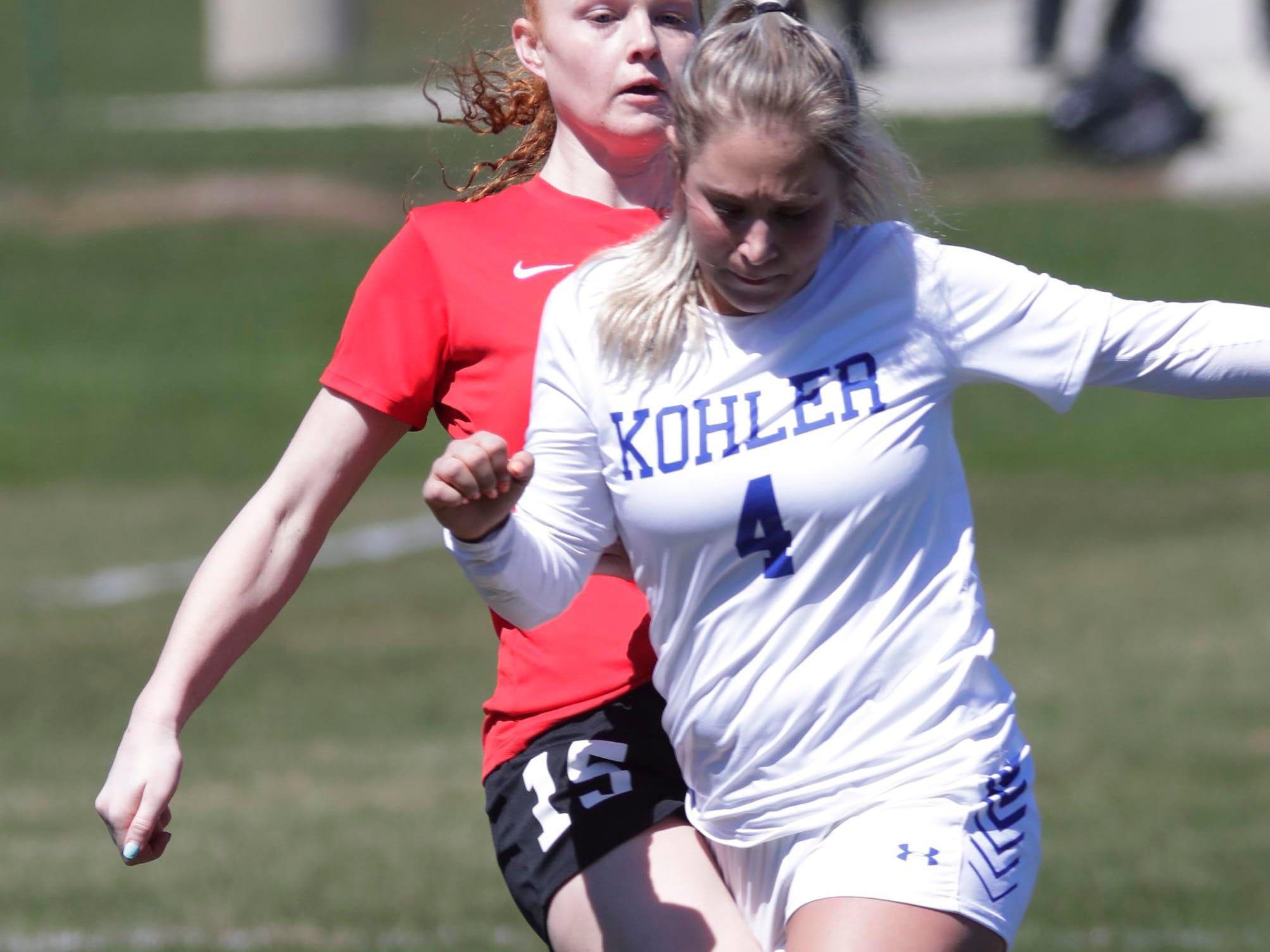 Kohler's Morgan Sell (4) moves the ball against Sheboygan South at the Sheboygan South Soccer tournament, Saturday, April 20, 2019, in Sheboygan, Wis.
