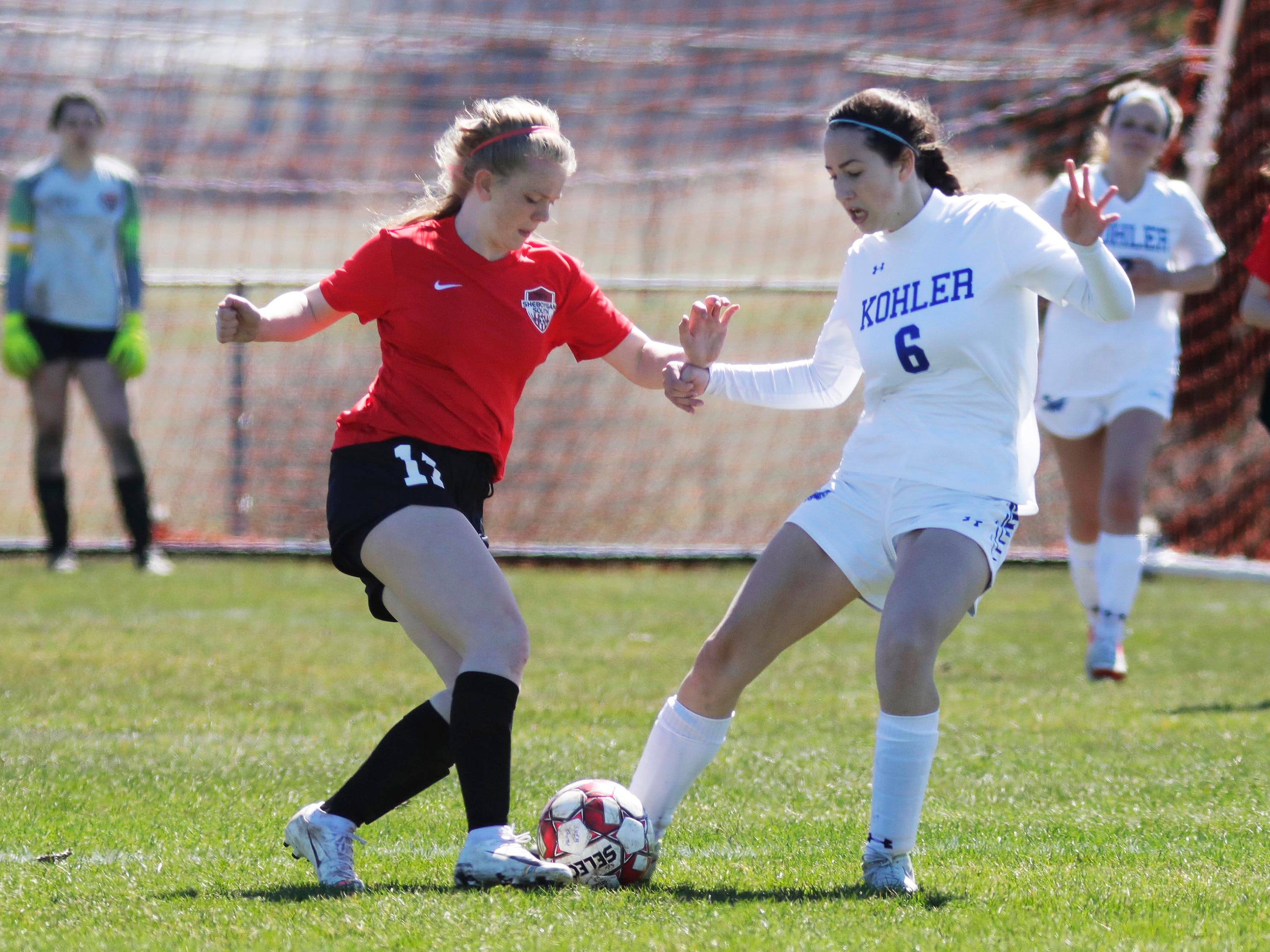 Sheboygan South's Lily Lunginbill (11) moves the ball by Kohler's Fiona Hidri (6) at the Sheboygan South Soccer tournament, Saturday, April 20, 2019, in Sheboygan, Wis.