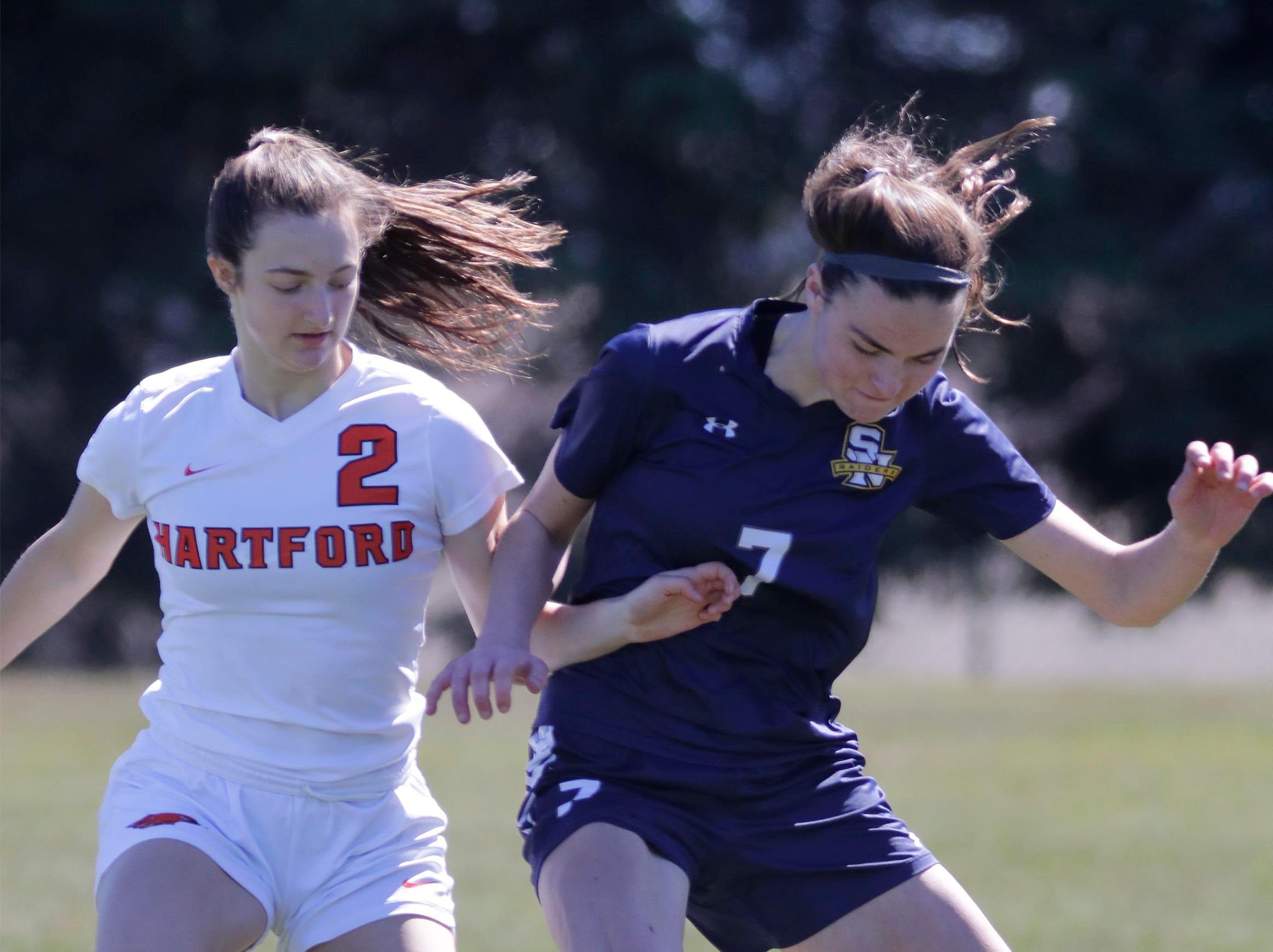 Hartford's Becca Stoeckmann (2) observes as Sheboygan North's Ashley English (7) maneuvers the ball, at the Sheboygan South Soccer tournament, Saturday, April 20, 2019, in Sheboygan, Wis.