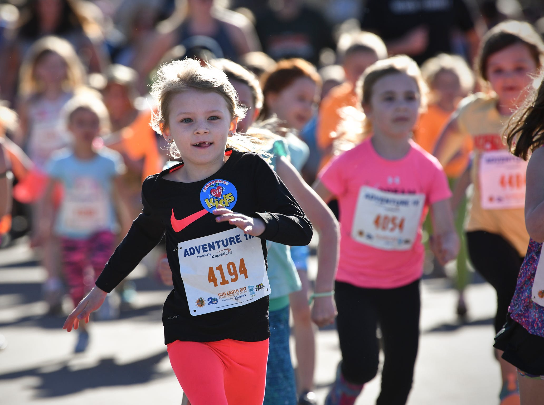 Runners get started for their race during the Kids Adventure 1K Friday in downtown St. Cloud.
