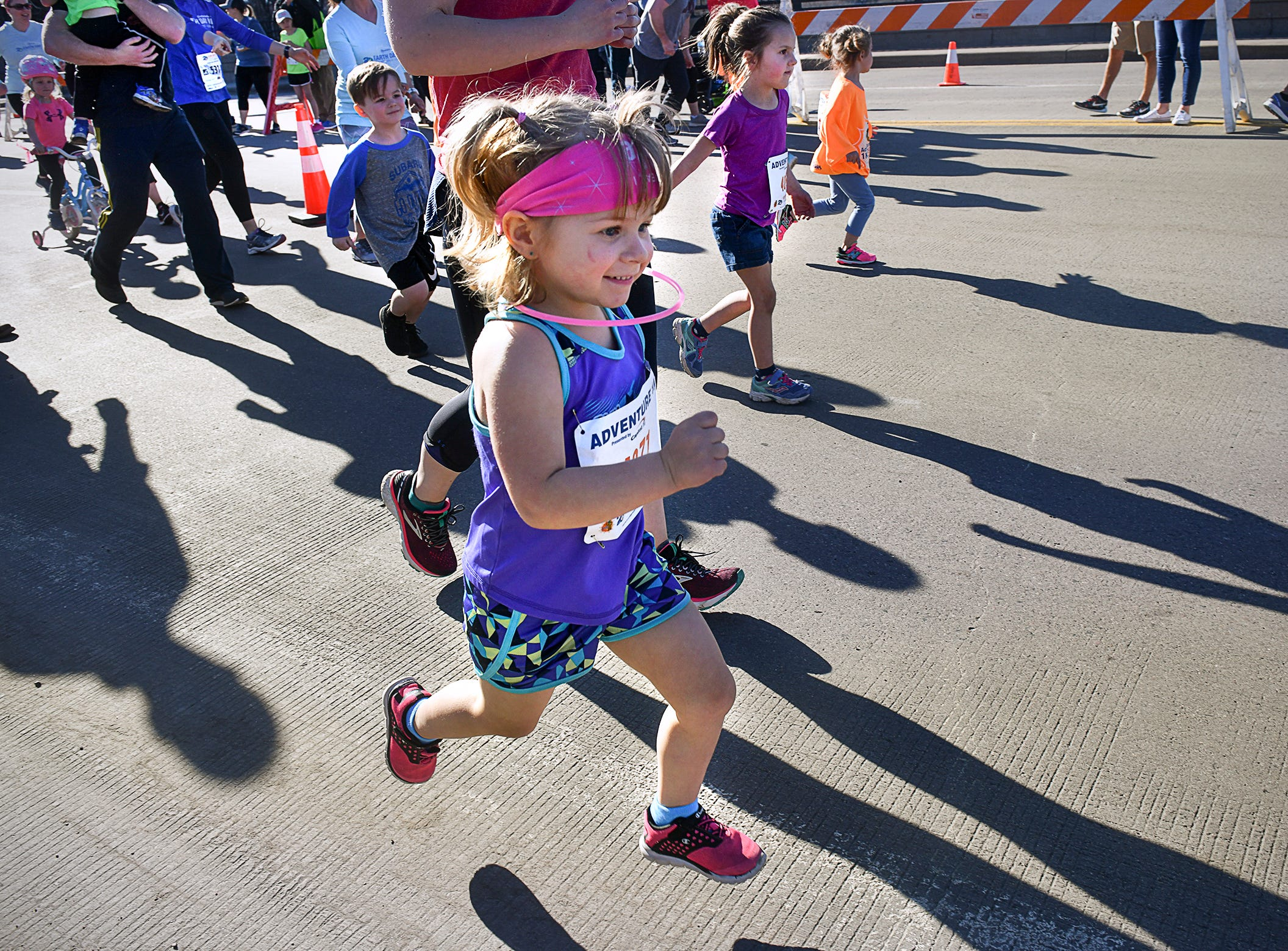 Runners leave the starting line during the Kids Adventure 1K Friday in downtown St. Cloud.