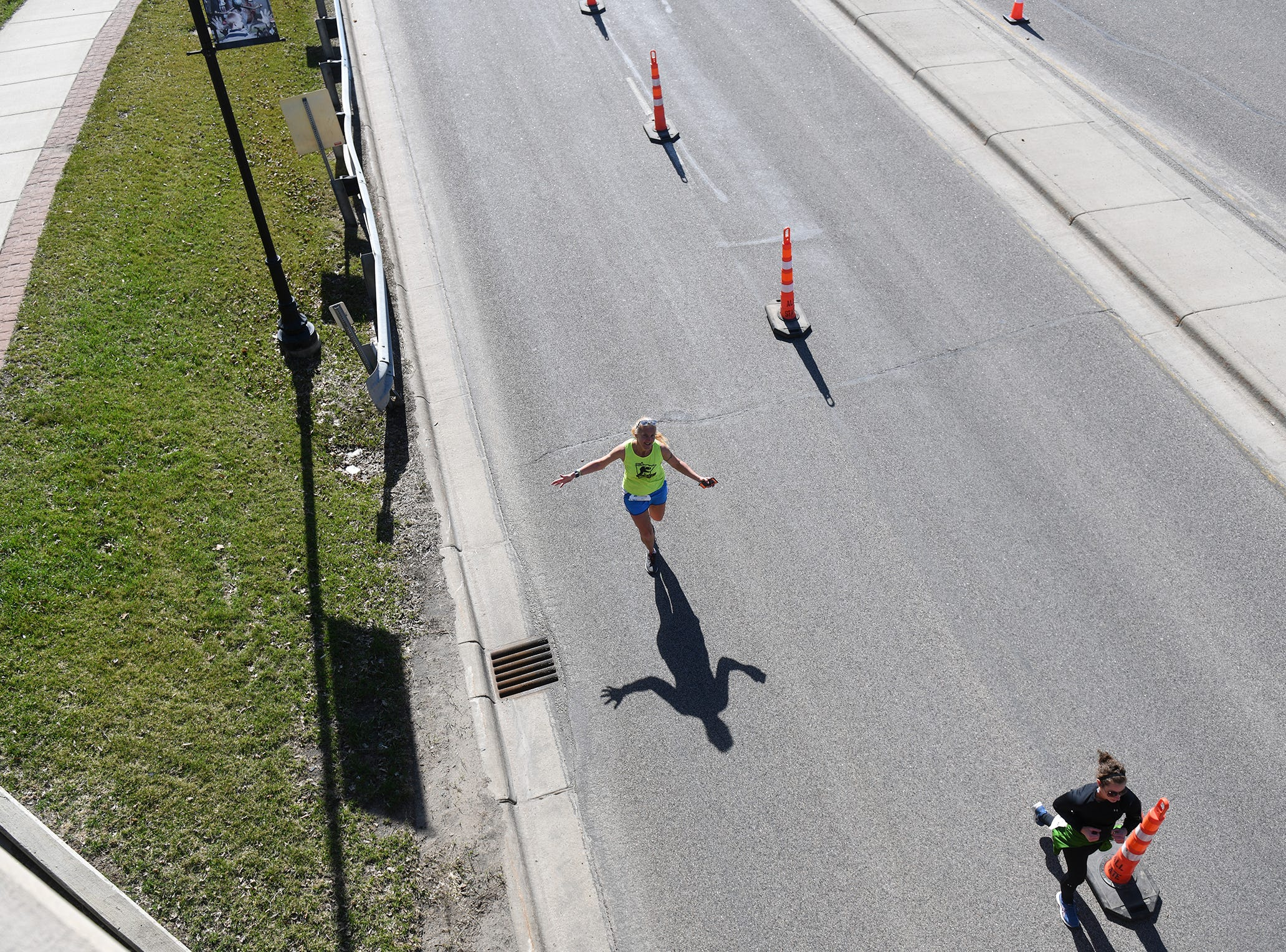Runners make their way toward the finish line Saturday, April 20, in downtown St. Cloud.