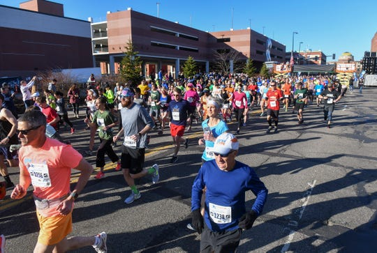 Runners leave the starting line during the Cetera Half Marathon as part of CentraCare Health Earth Day Run activities Saturday, April 20, in downtown St. Cloud.