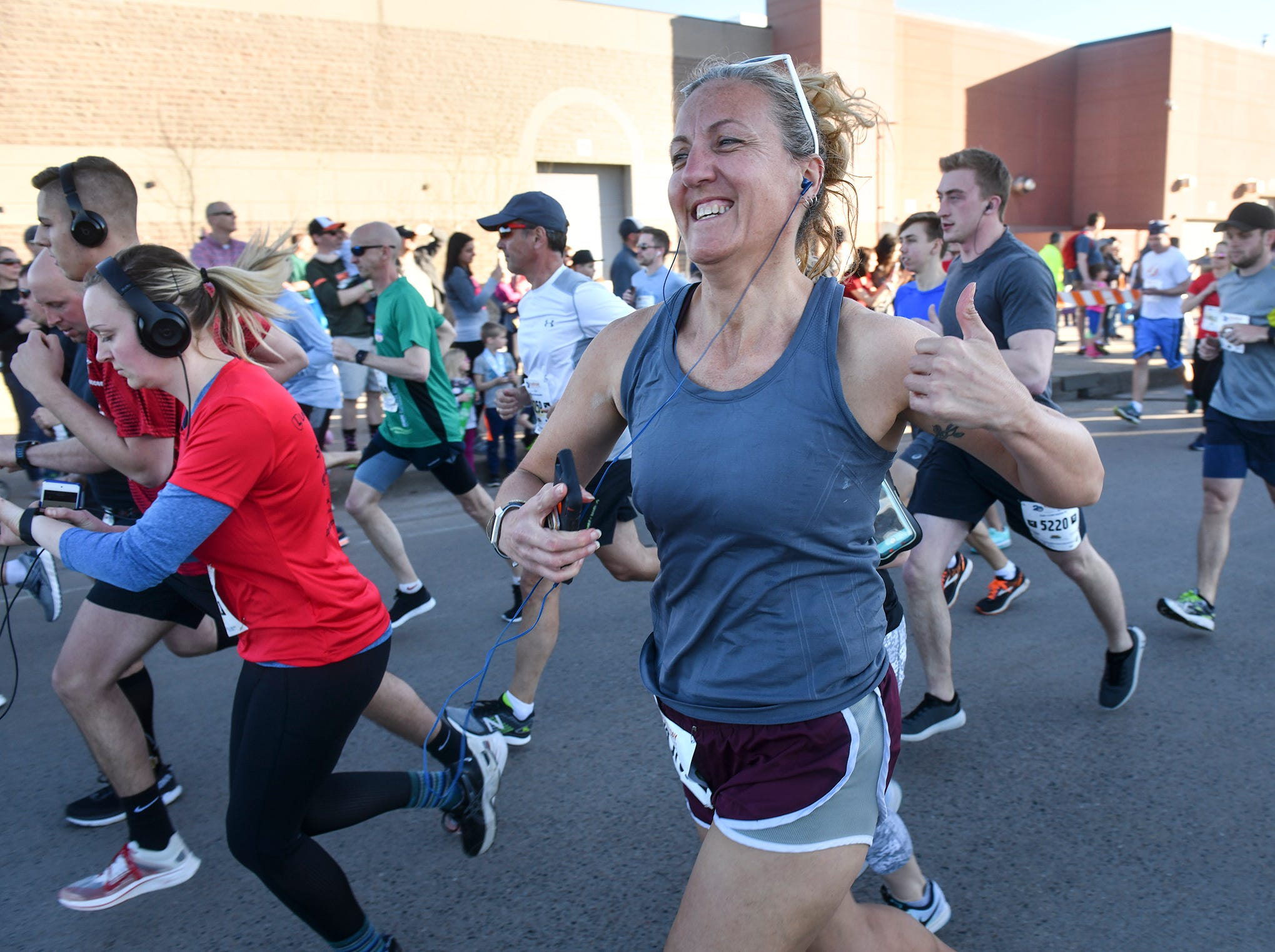 Runners leave the starting line for the the St. Cloud Subaru 5K run/walk Friday in downtown St. Cloud.