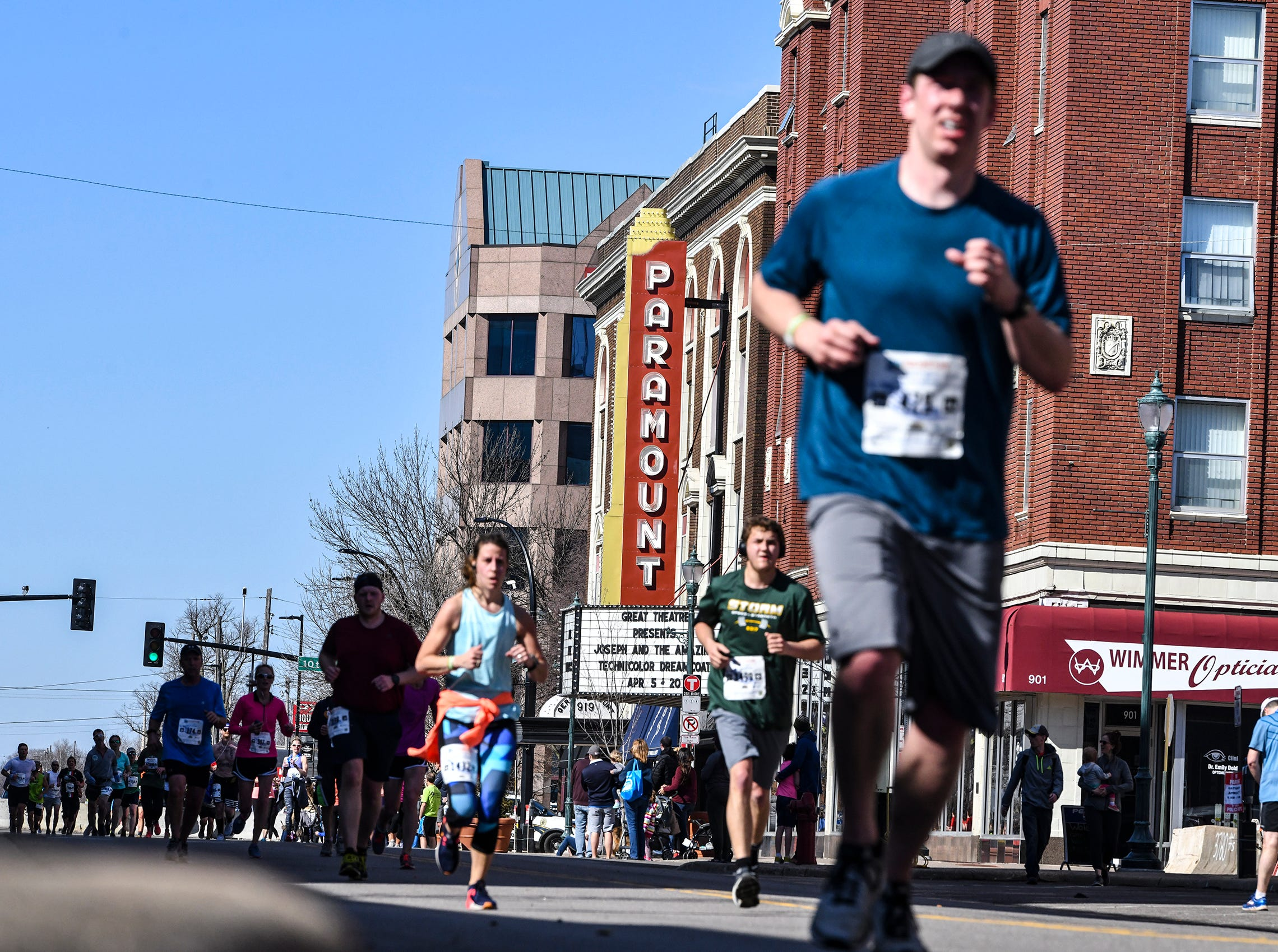 Runners follow the course down St. Germain Street toward the finish line during the Cetera Half Marathon as part of CentraCare Health Earth Day Run activities Saturday, April 20, in downtown St. Cloud.