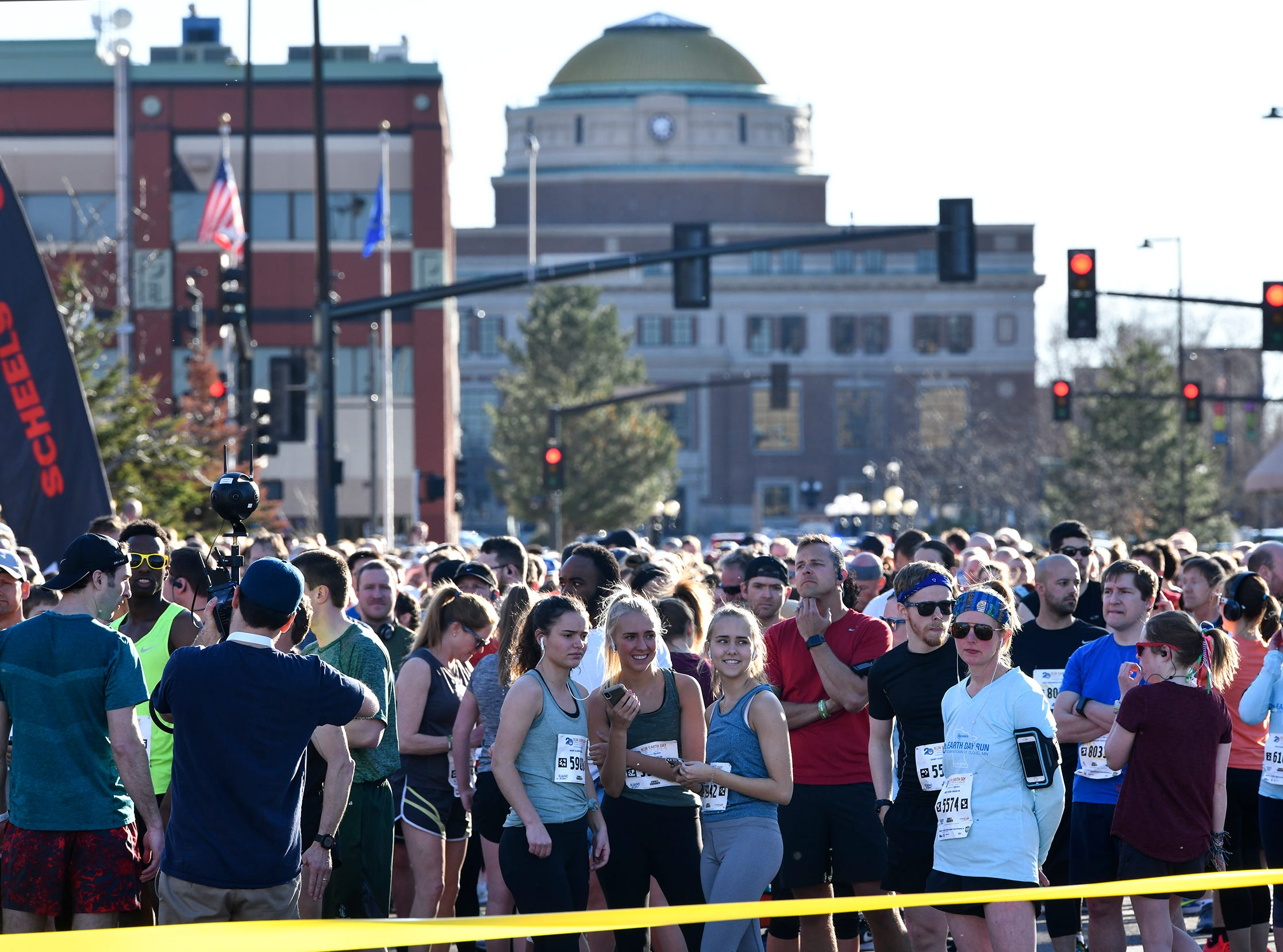 Runners gather for the start of the St. Cloud Subaru 5K run/walk Friday in downtown St. Cloud.